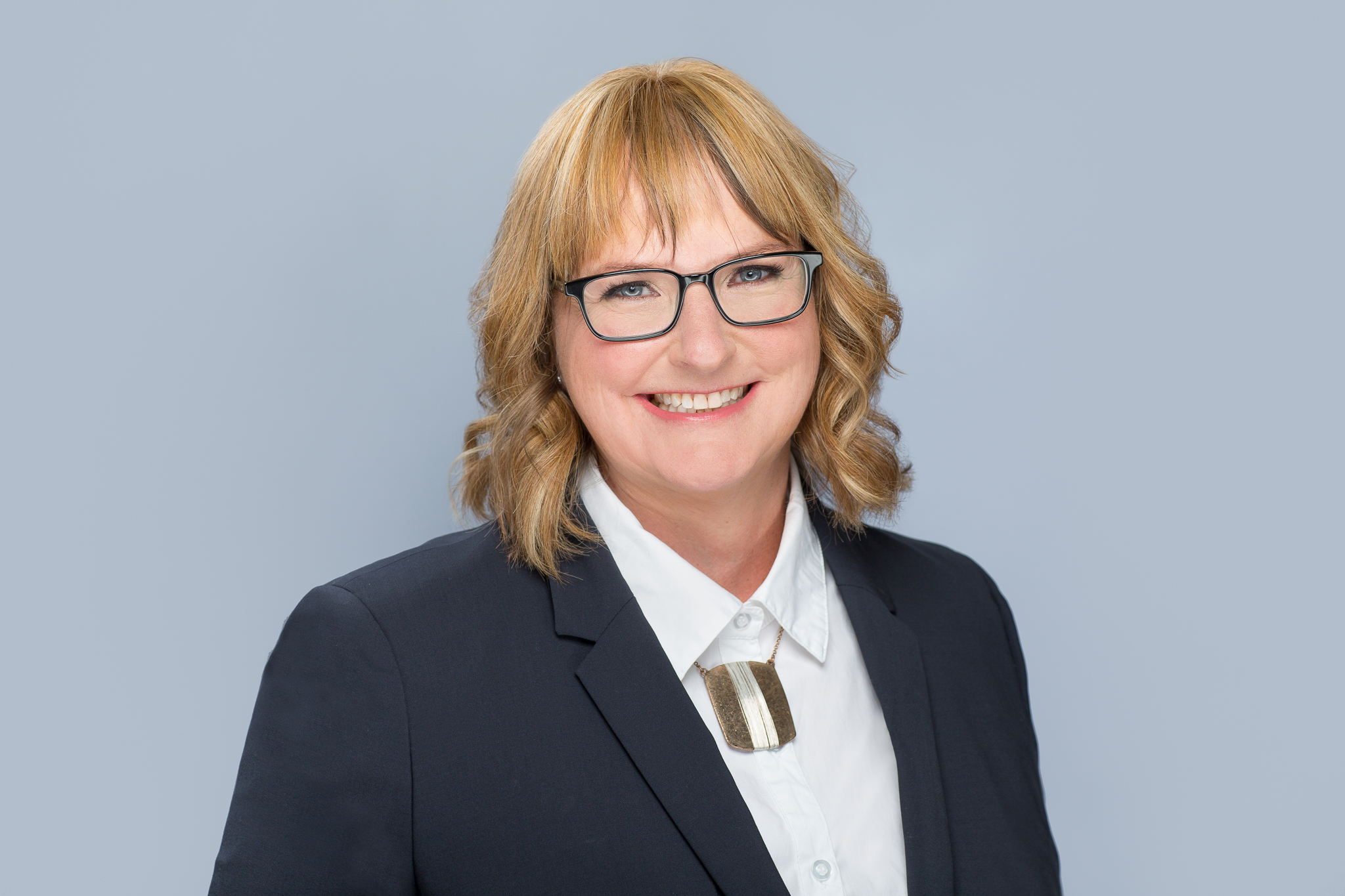 A corporate style headshot with a bright, fresh look