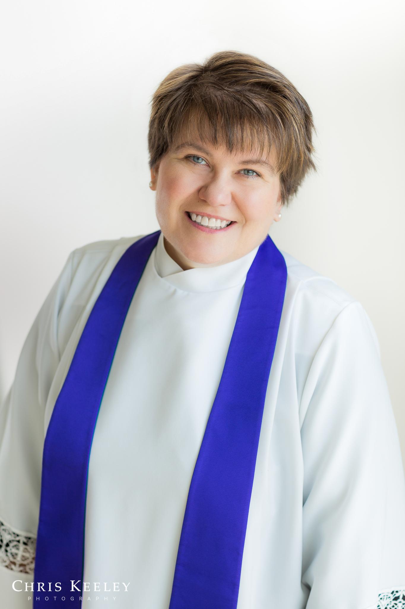 A chaplain headshot with a warm, glowing feel