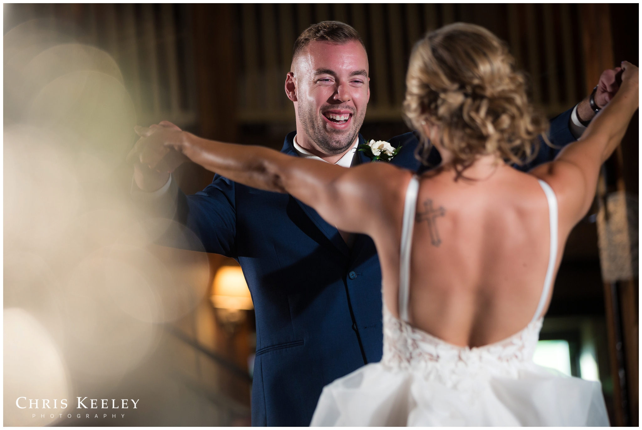 groom-smiling-at-bride-first-dance.jpg