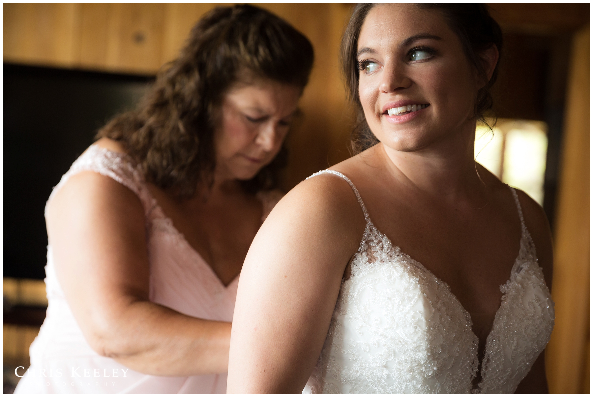 mother-of-bride-helping-daughter-into-dress.jpg