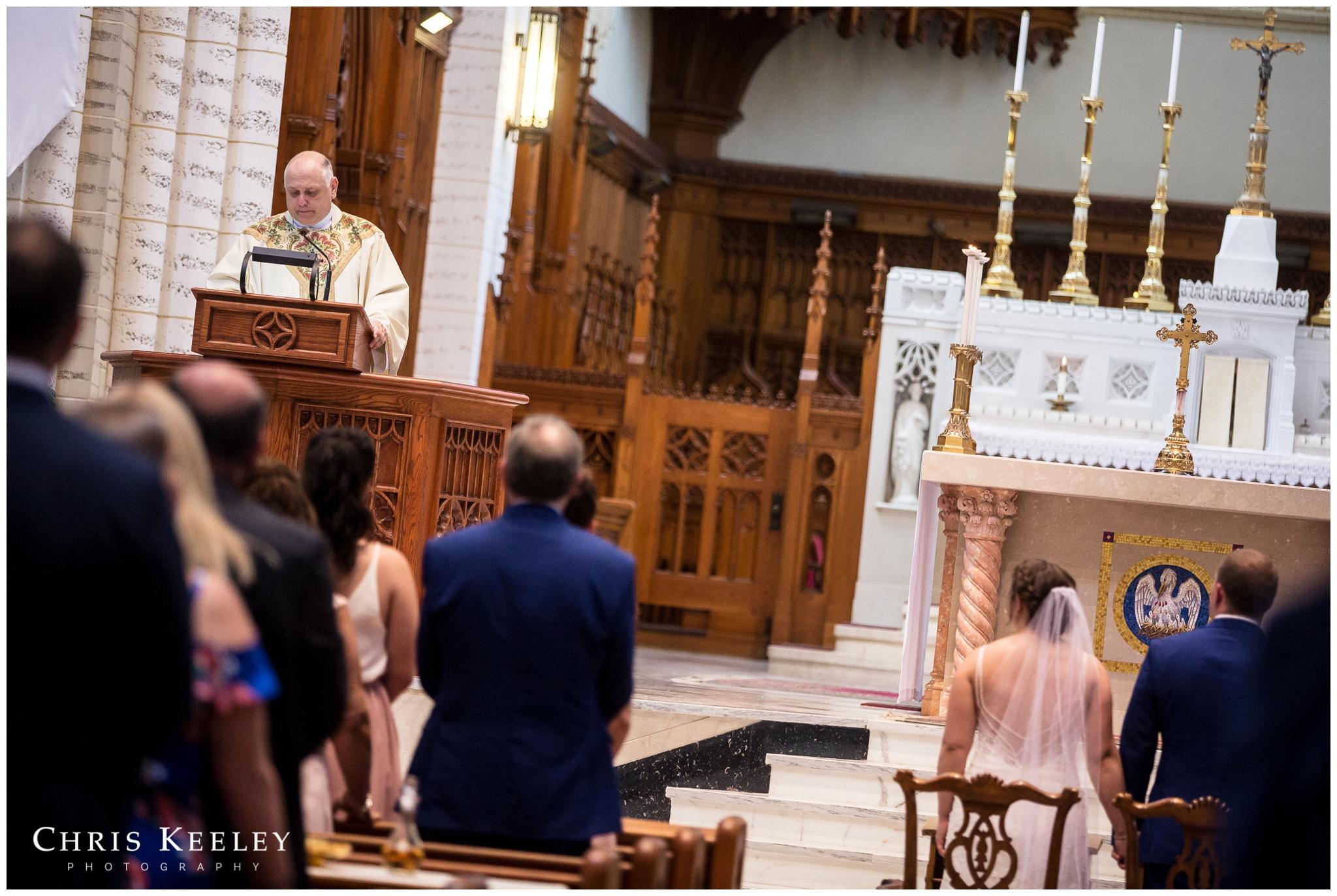 priest-speaking-during-ceremony.jpg