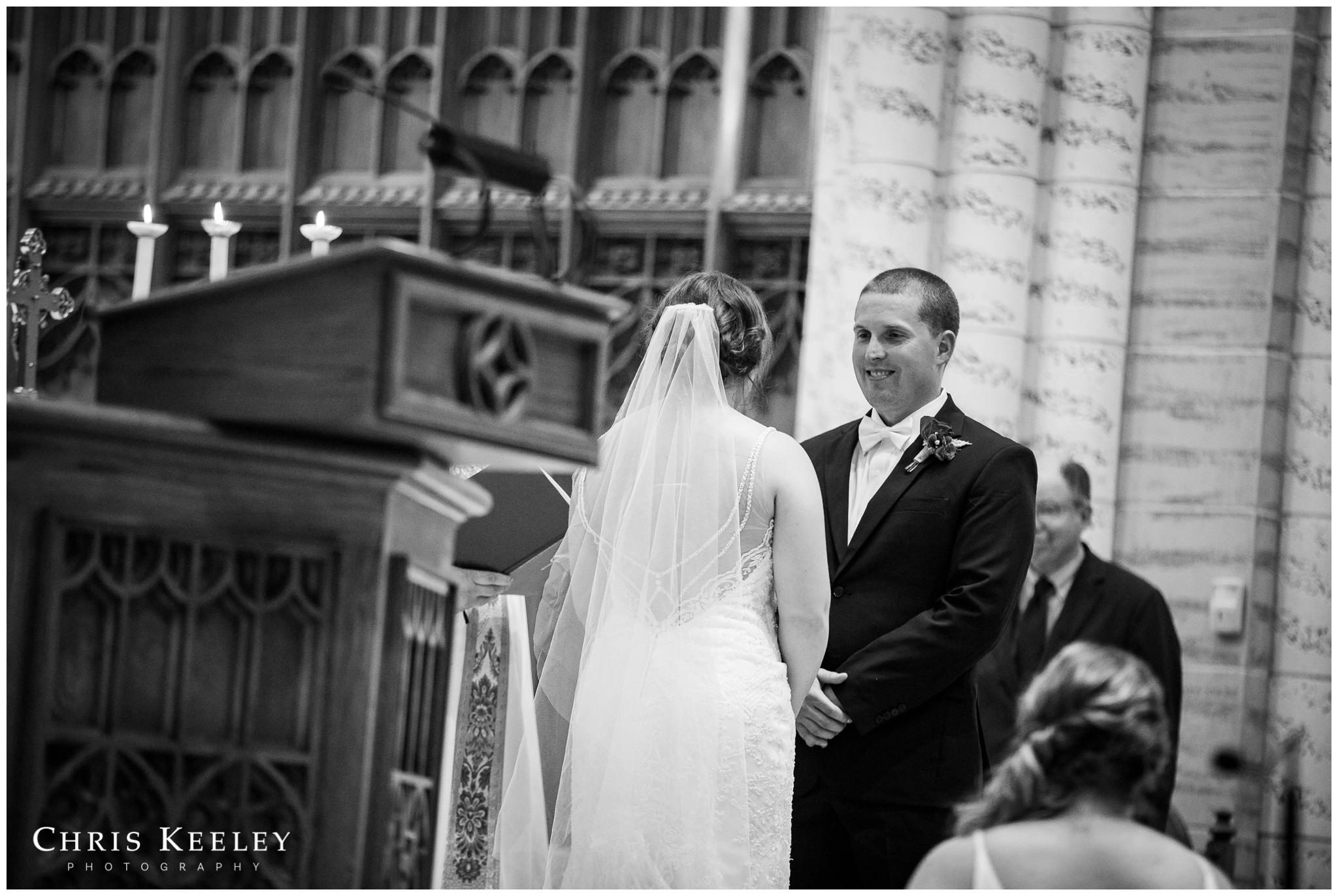 groom-looking-at-bride-during-ceremony.jpg