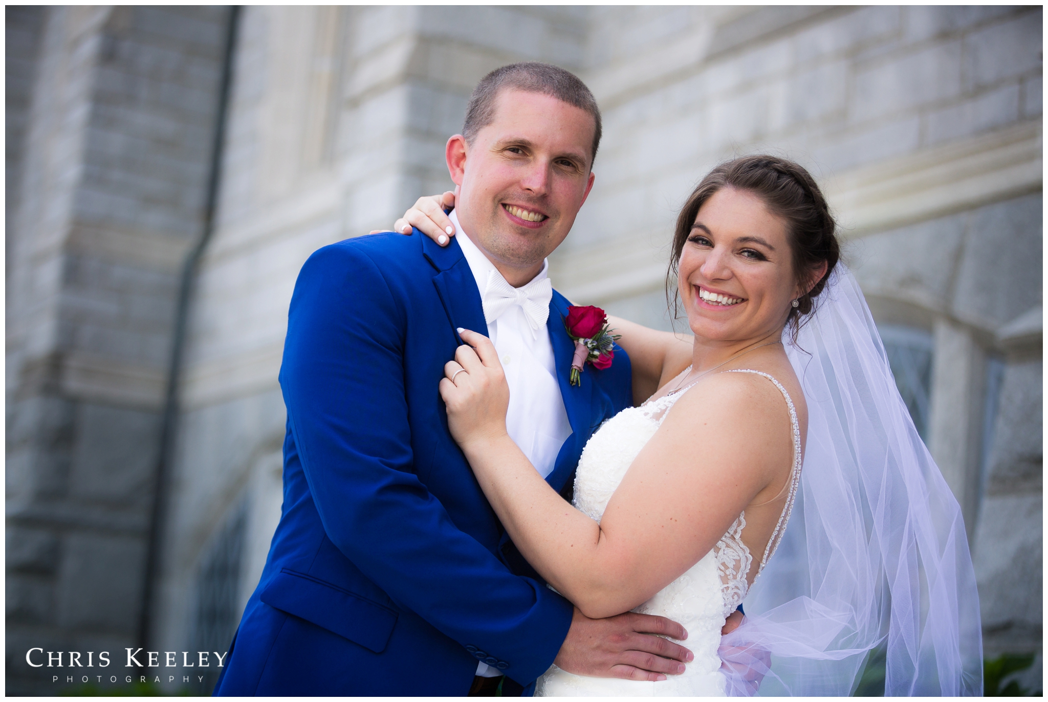 bride-and-groom-smiling-outside-church.jpg