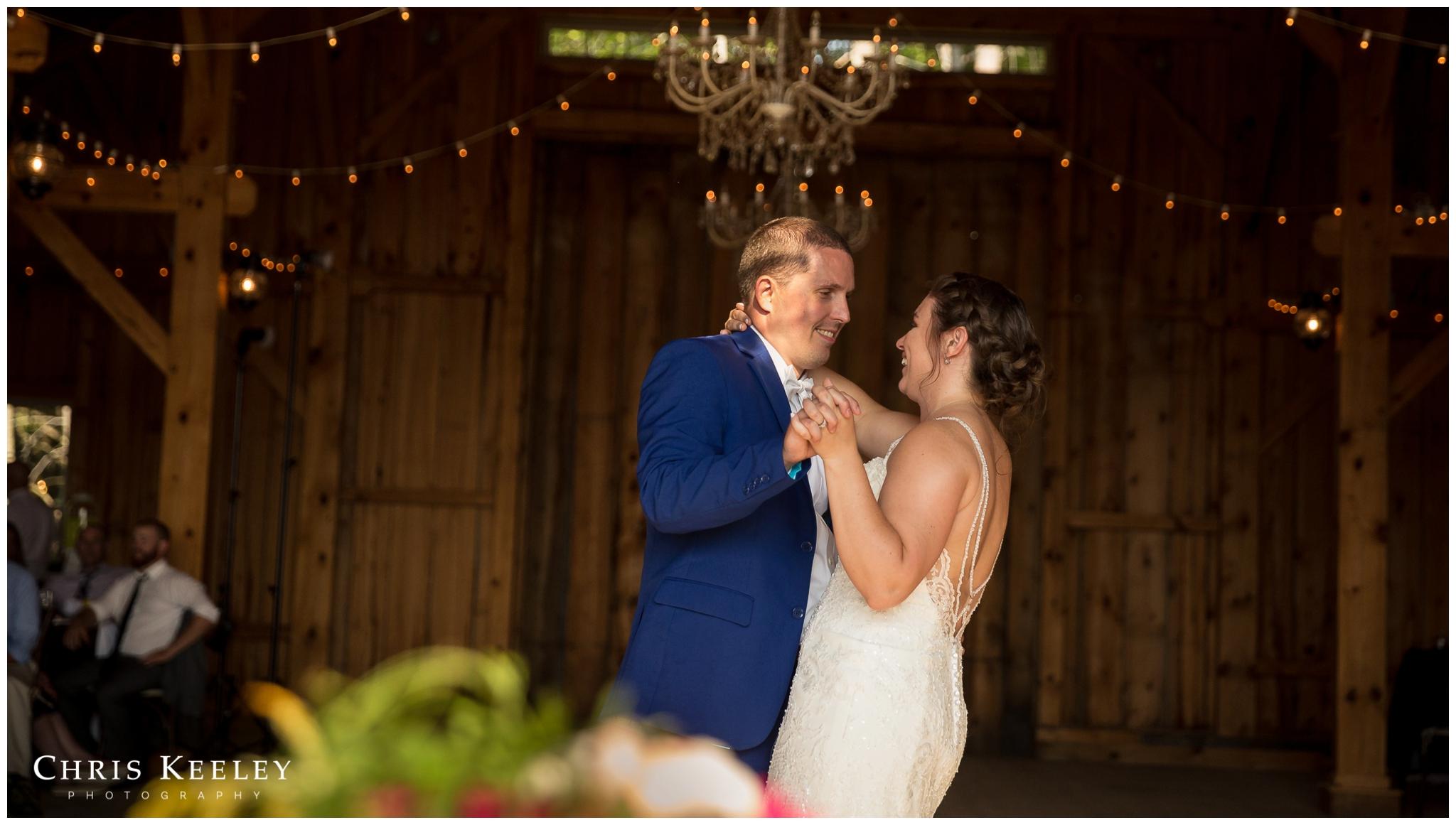 bride-groom-smiling-during-first-dance.jpg