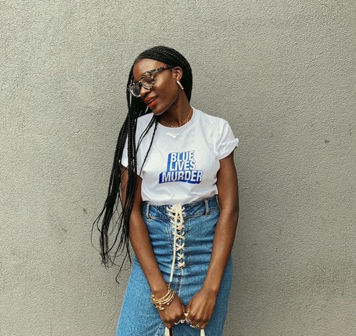 White Blue Lives Murder Shirt   (worn by Baltimore based writer, researcher, organizer, and womanist born in Liberia, West Africa, Bilphena Yahwon,    @goldwomyn   )