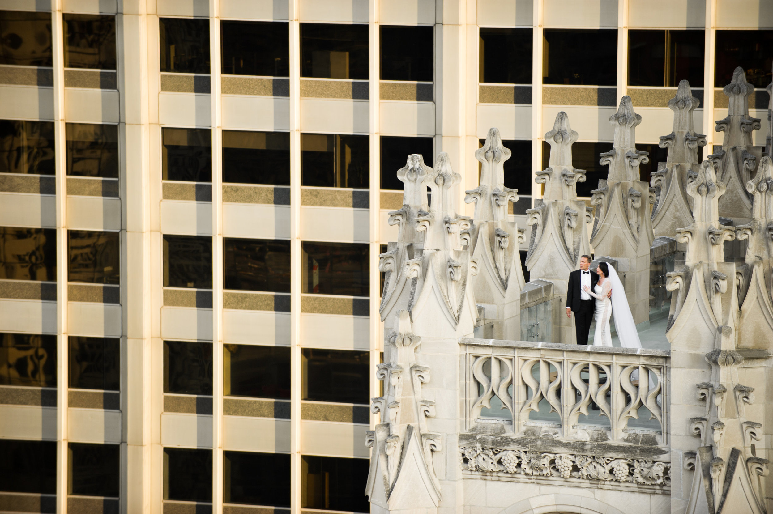 I shot this image in June; Dana and Nick were married at the Tribune Tower and planned for their room to face it so we could get a further away shot of them atop the tower. Making this shot has been the highlight of shooting for me thus far this year!