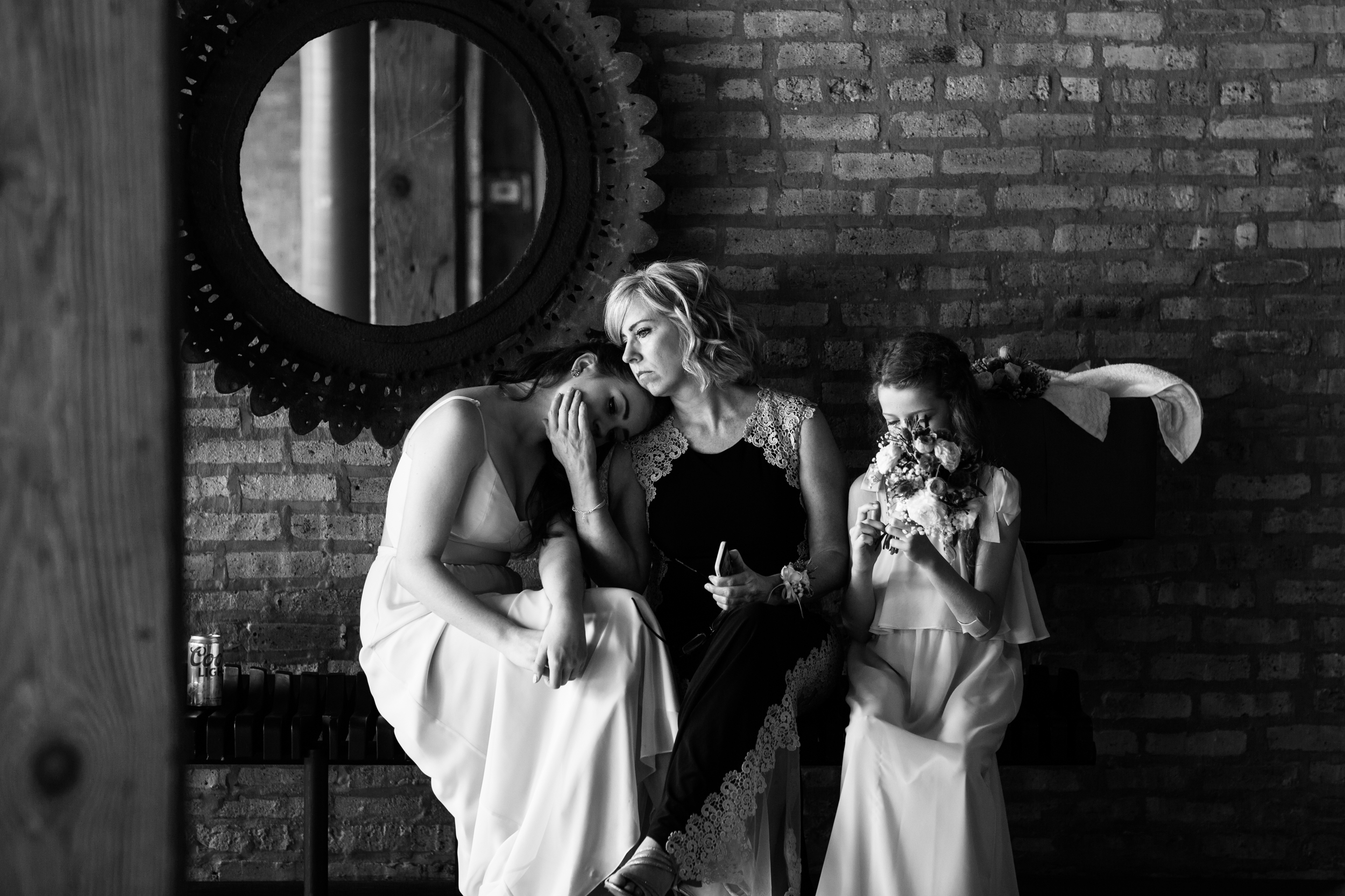 Quiet moments like these are my most favorite images from weddings. This is Maria's step mom and her two sisters just a few moments before the ceremony.