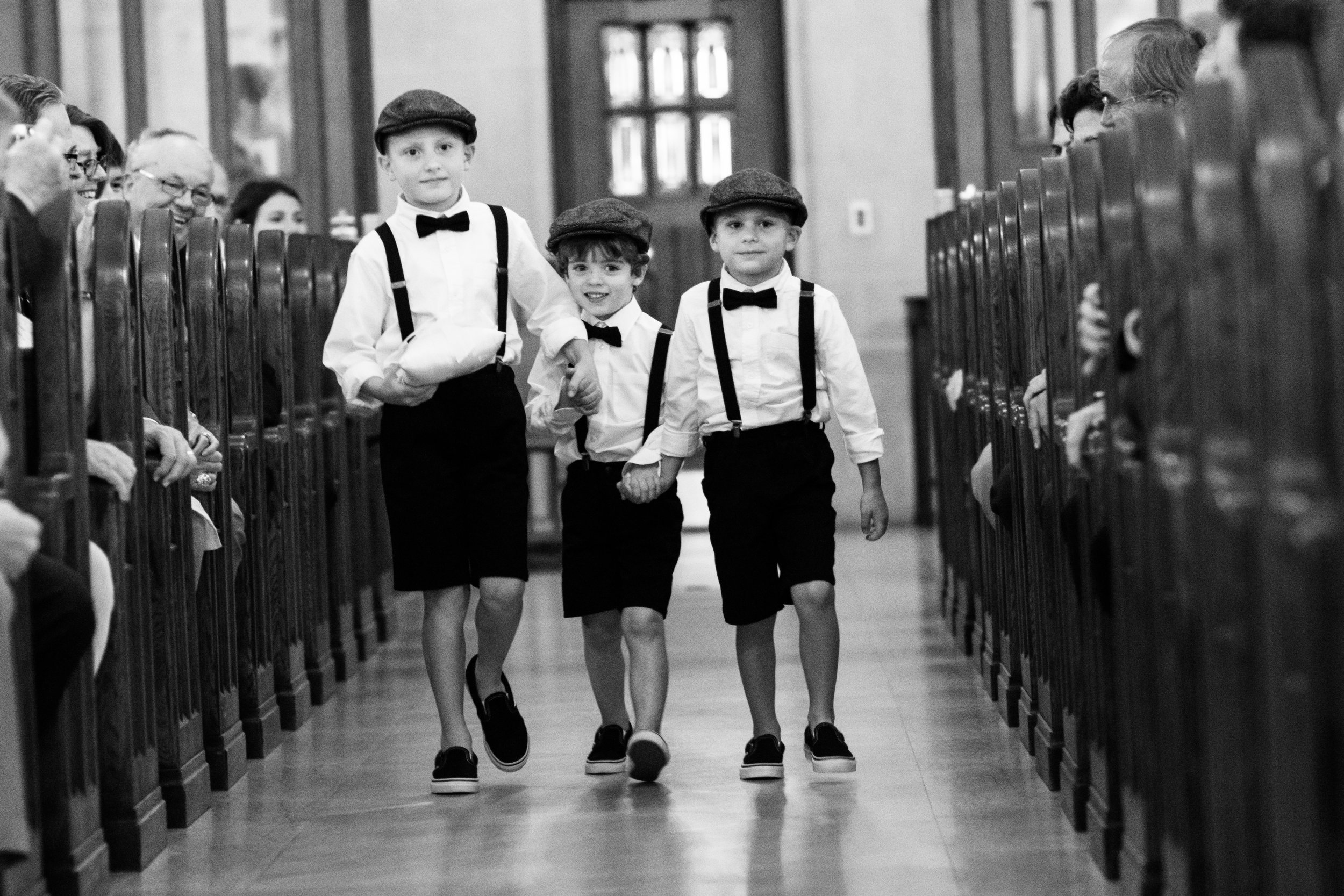 Ring bearers at wedding ceremony