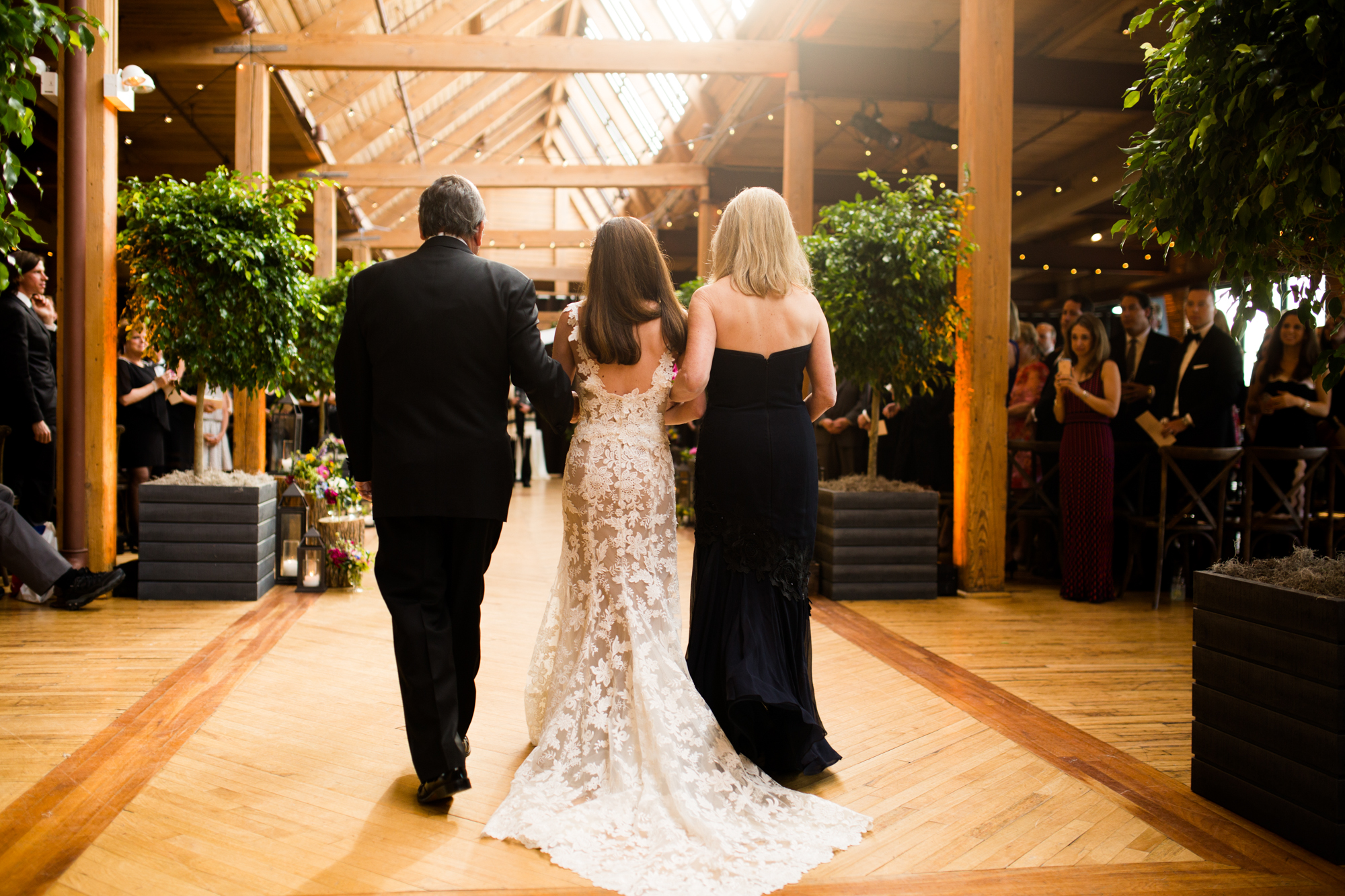 Bride walks down the aisle at wedding ceremony in Chicago at Bridgeport Art Center