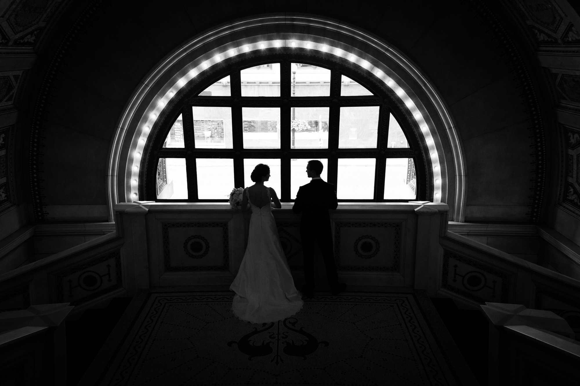 Silhouette portrait of bride and groom at Chicago Cultural Center