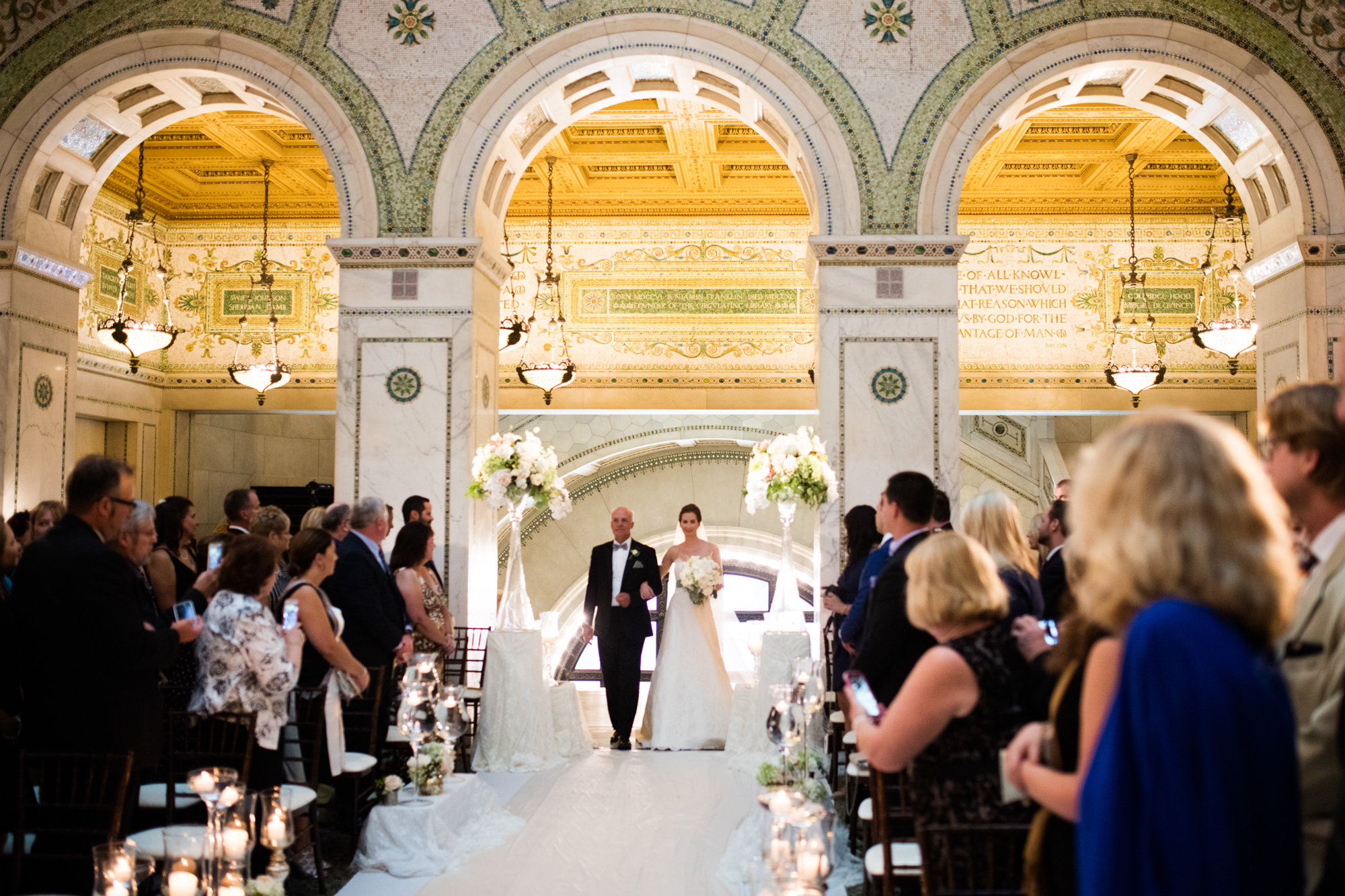 Bride and her father walk down the aisle at Chicago Cultural Center Wedding Ceremony