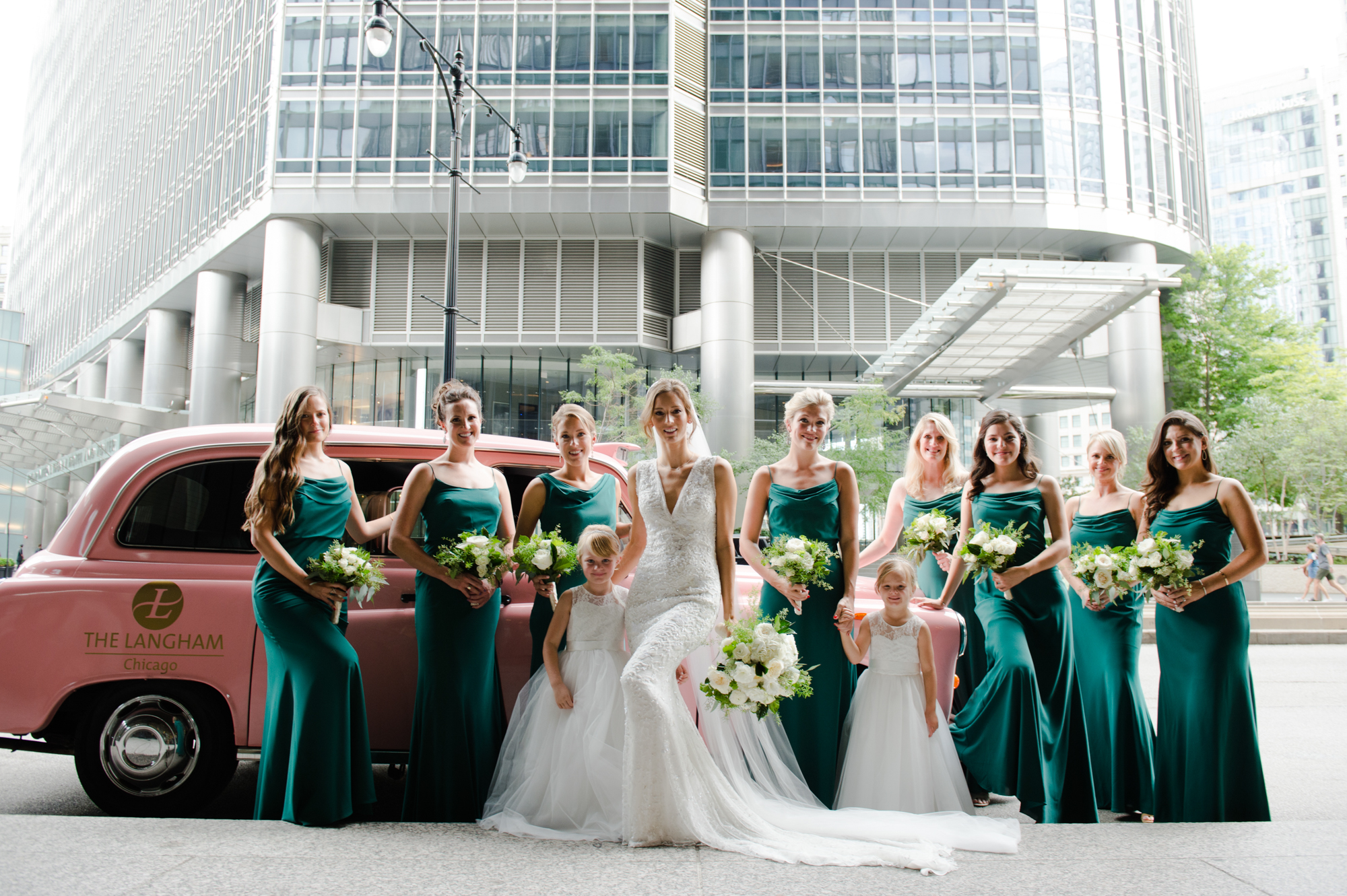 Portraits of bridal party outside the Langham Hotel in Chicago