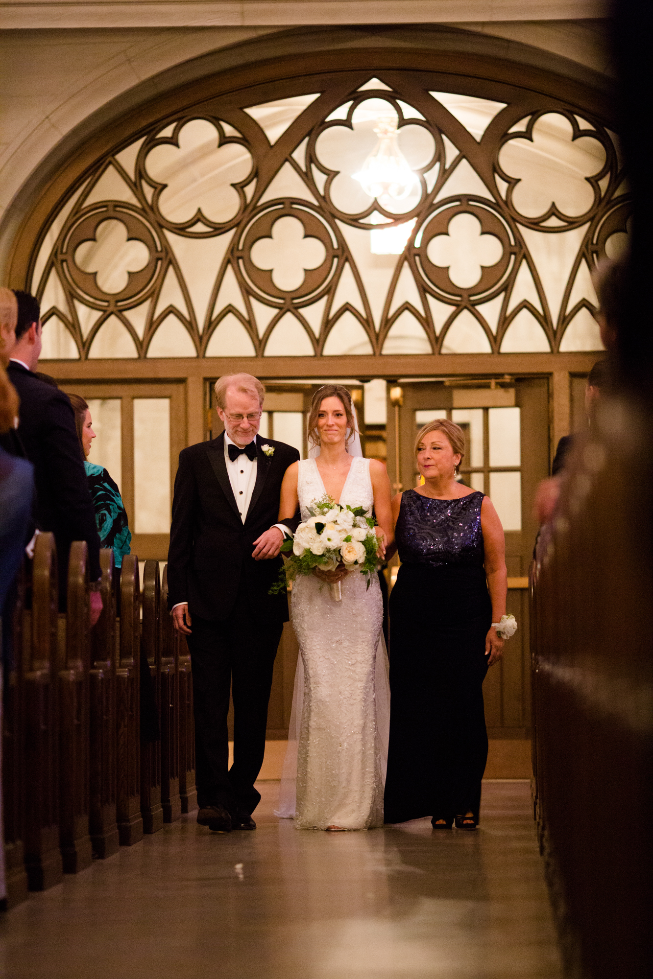 Bride walks down the aisle at St James Chapel wedding ceremony.