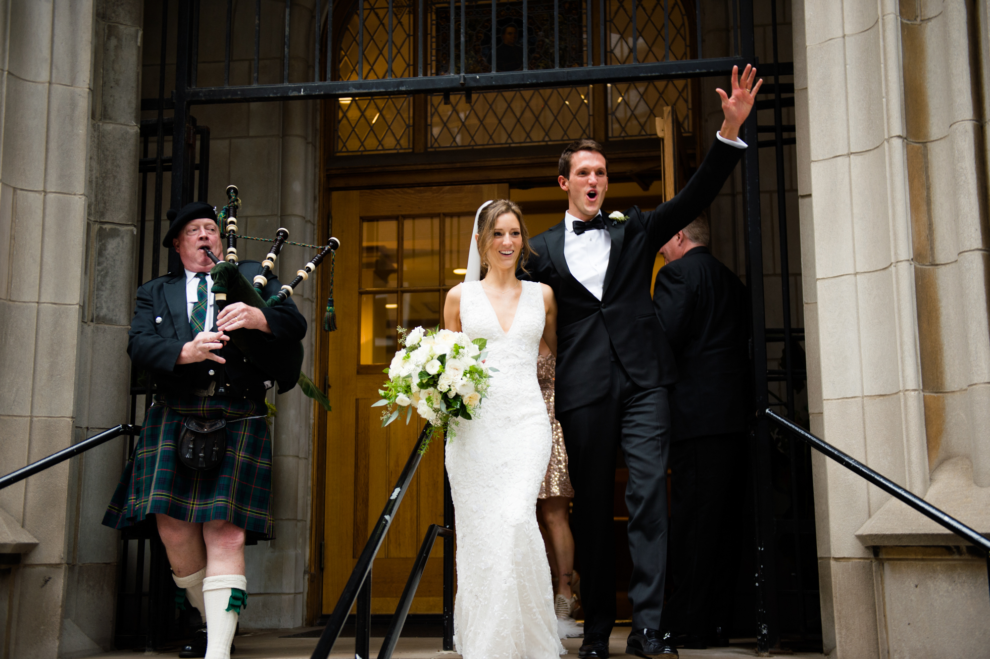 Bride and groom exit wedding ceremony at St James Chapel in Chicago