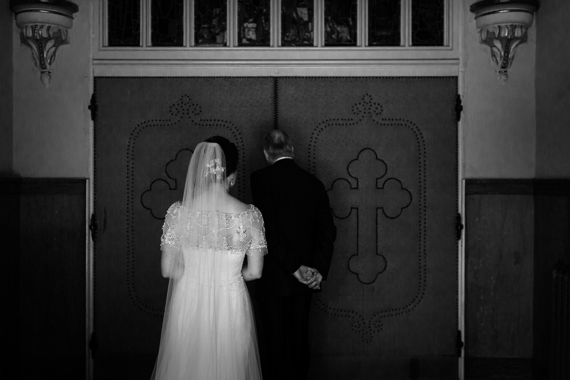 Bride and father wait for wedding ceremony to begin at St Michael's in Old Town, Chicago