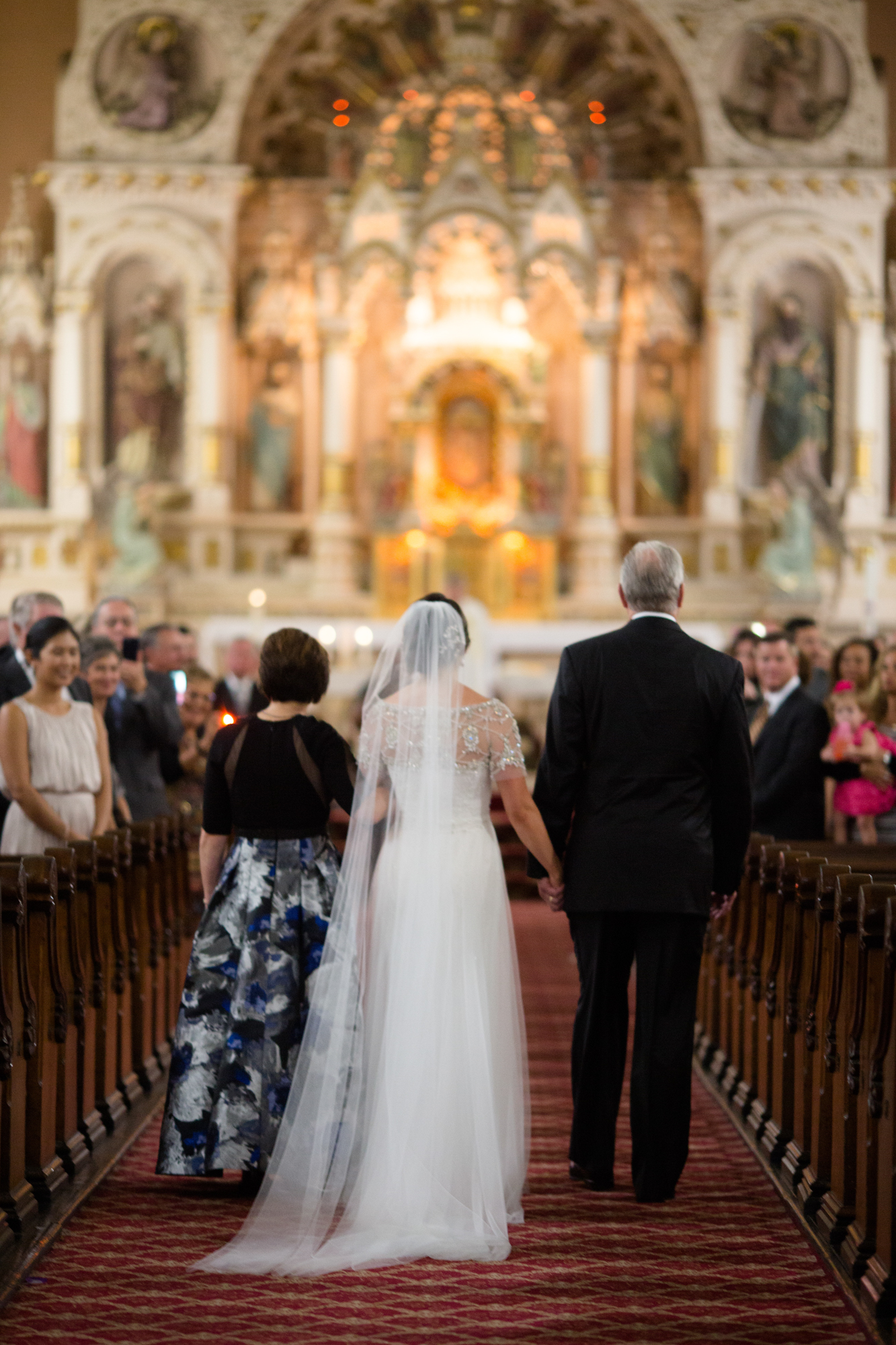 Bride and her parents walk down the aisle at St Michaels Old Town wedding ceremony in Chicago