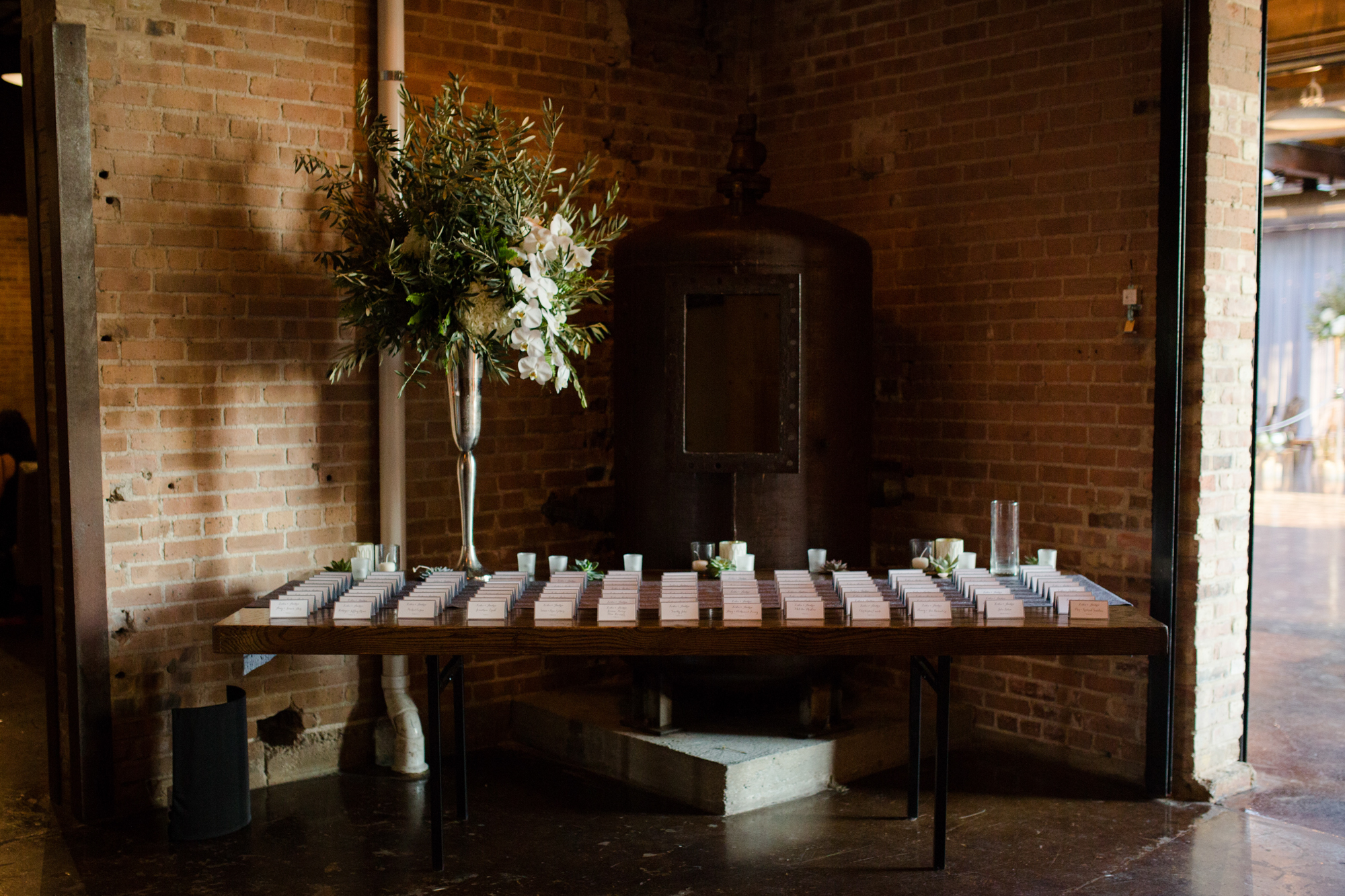 Escort card table at modern Morgan Manufacturing wedding