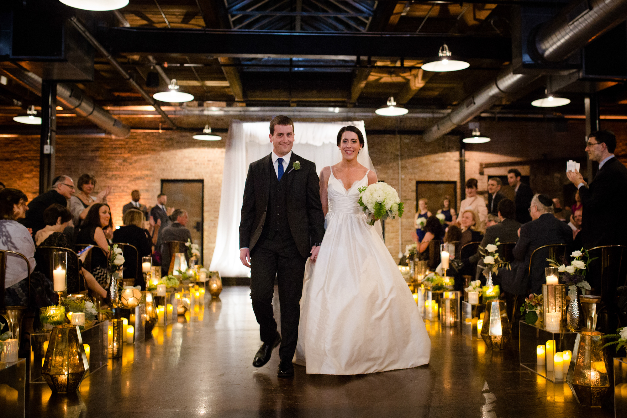 Bride and groom exit ceremony at Morgan Manufacturing in Chicago