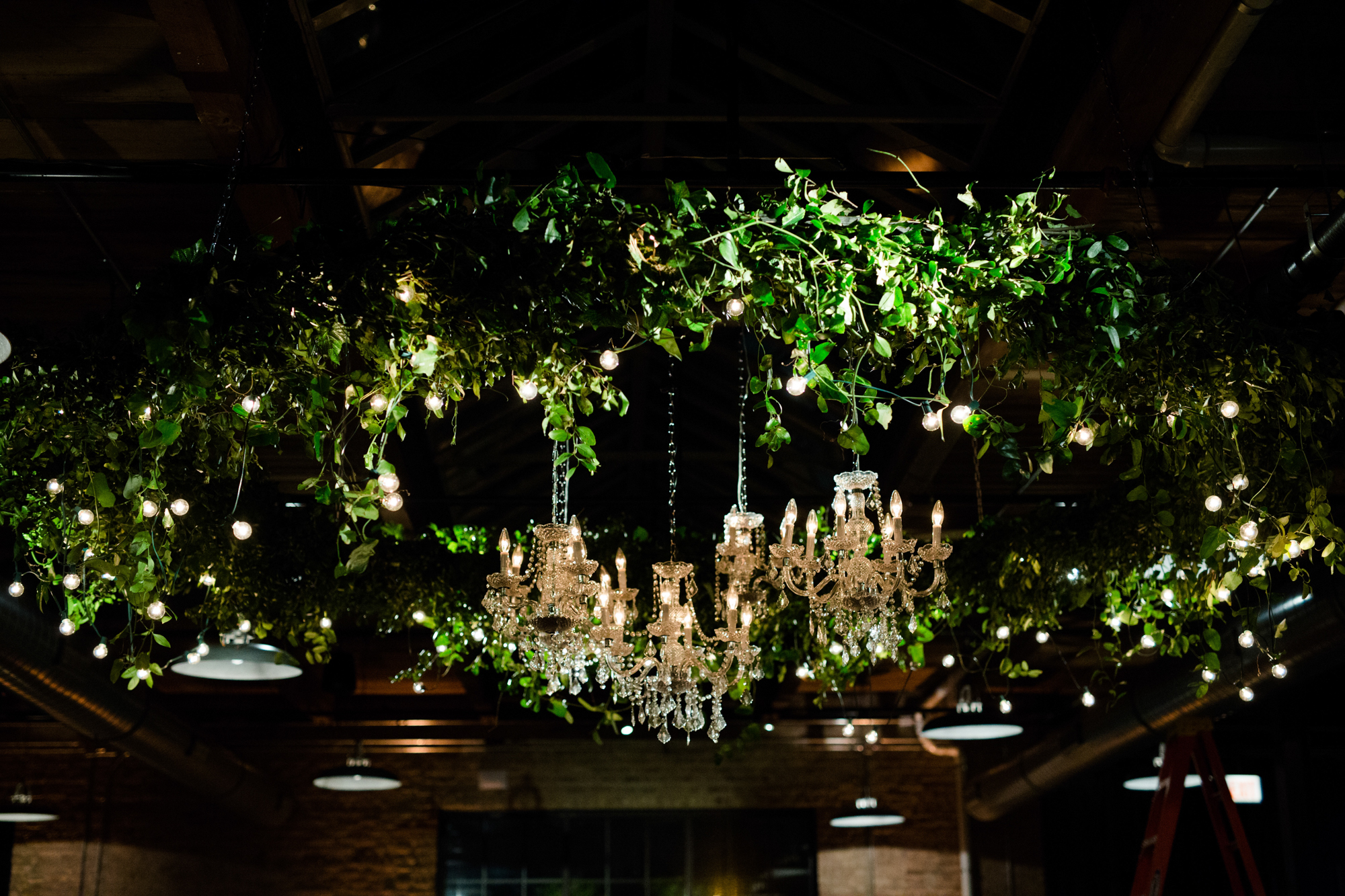 Greenery chandelier at Morgan Manufacturing wedding