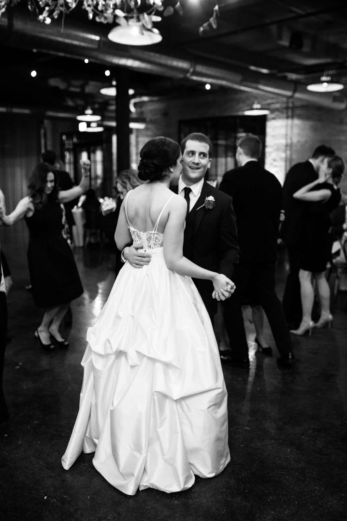 Bride and groom dancing at Morgan Manufacturing wedding