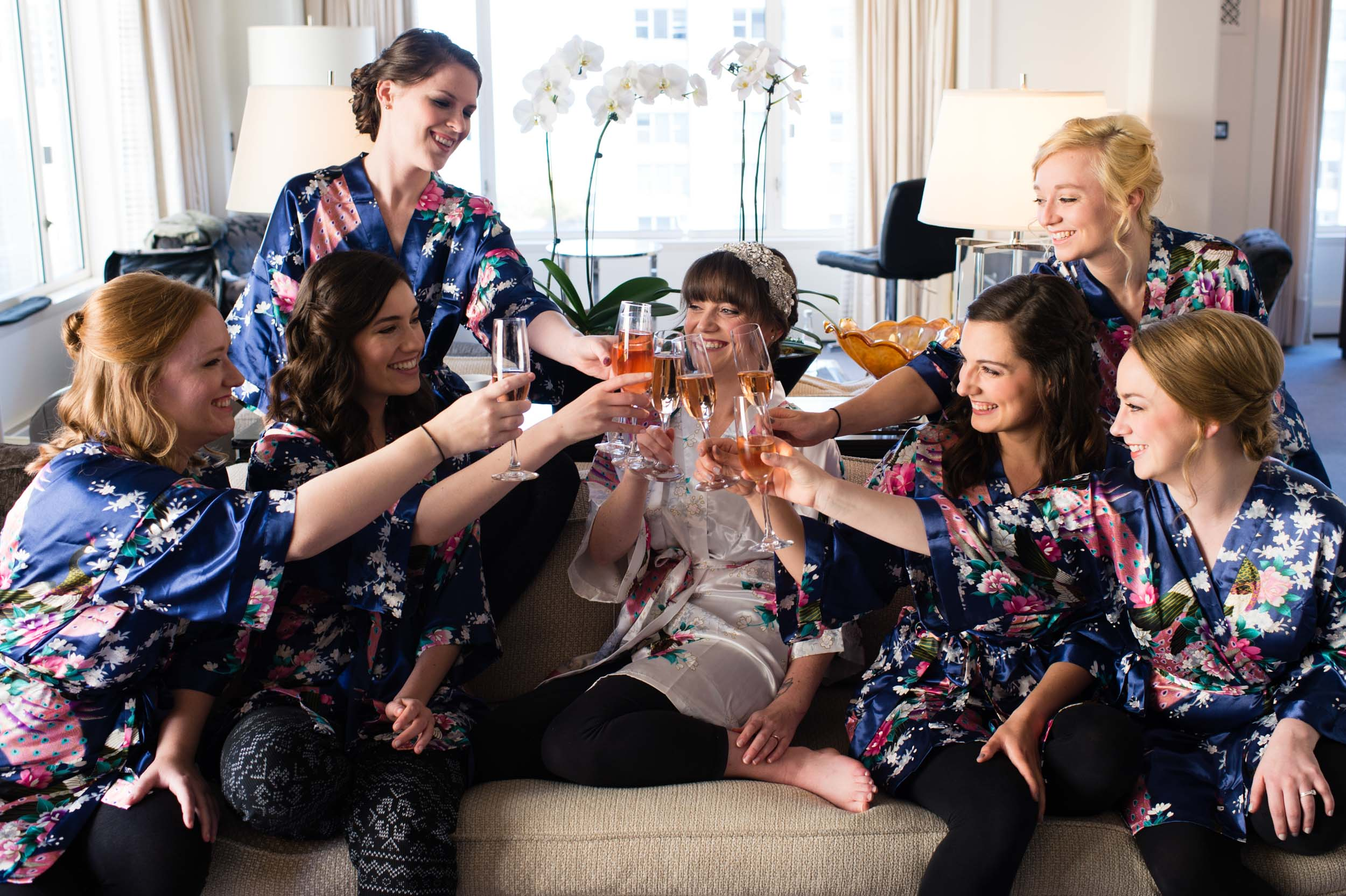 Bride and bridesmaids celebrate wedding morning at Peninsula Hotel Chicago