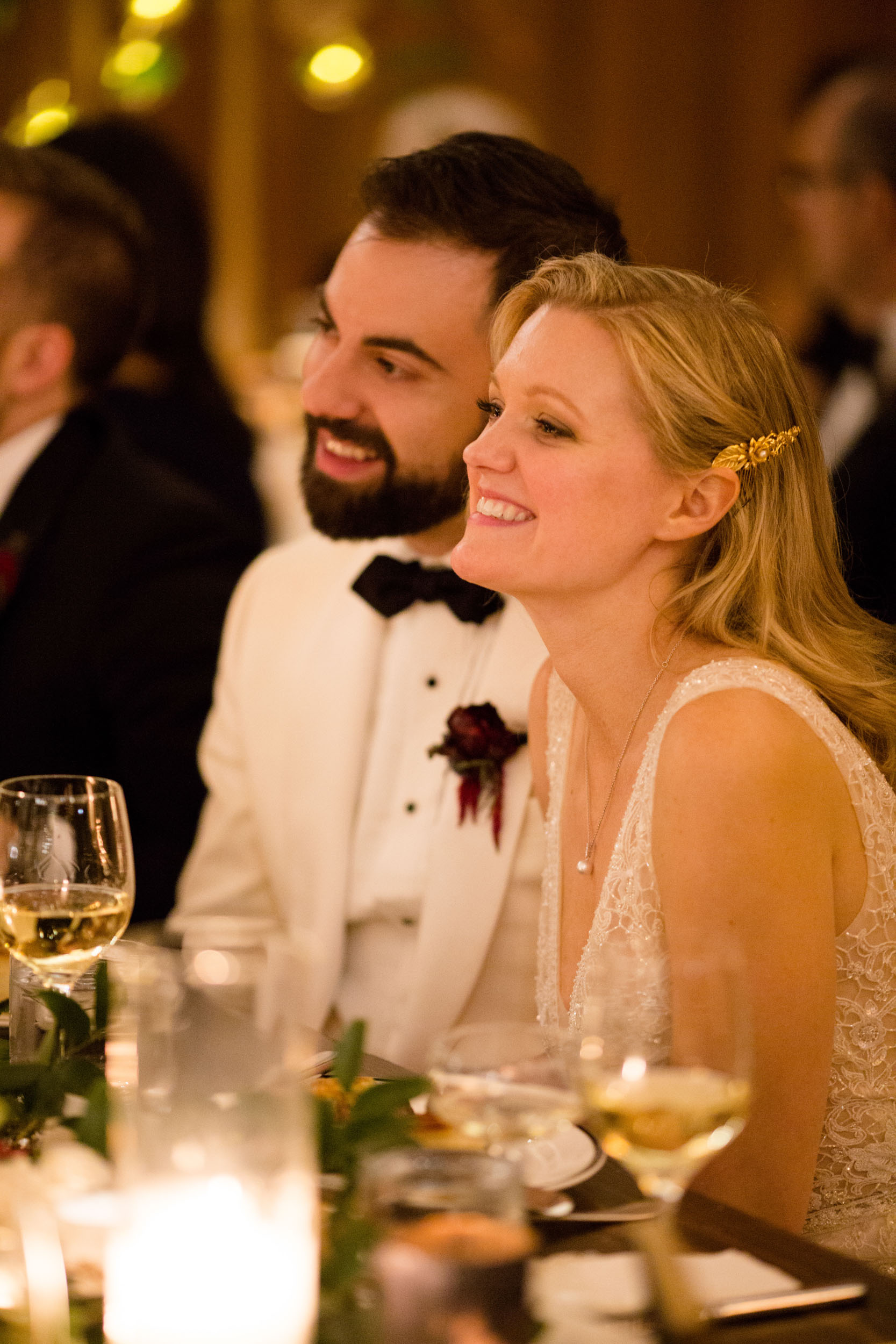 Bride and groom listen to toasts at Chicago Athletic Association wedding