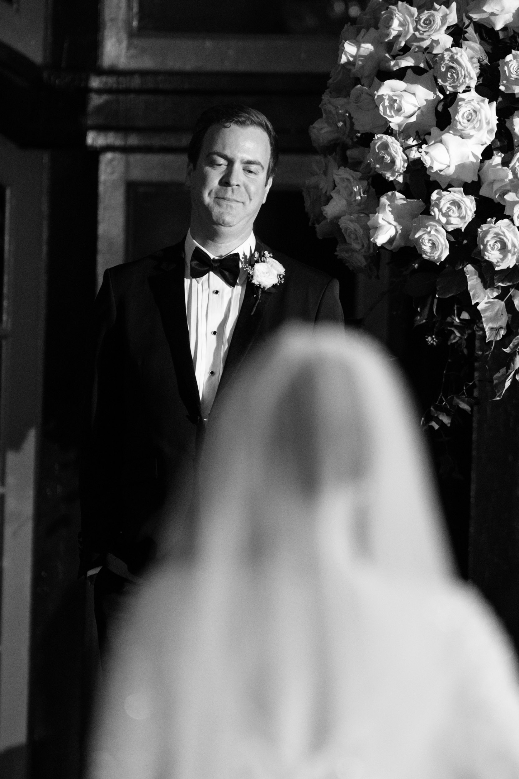 Groom sees bride for first time on wedding day as she walks down the aisle at Chicago Athletic Association wedding ceremony.