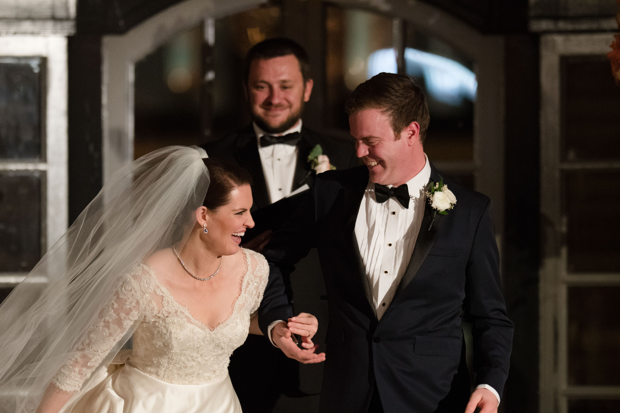 Bride and groom exit wedding ceremony in the Madison Ballrom at the Chicago Athletic Association Hotel