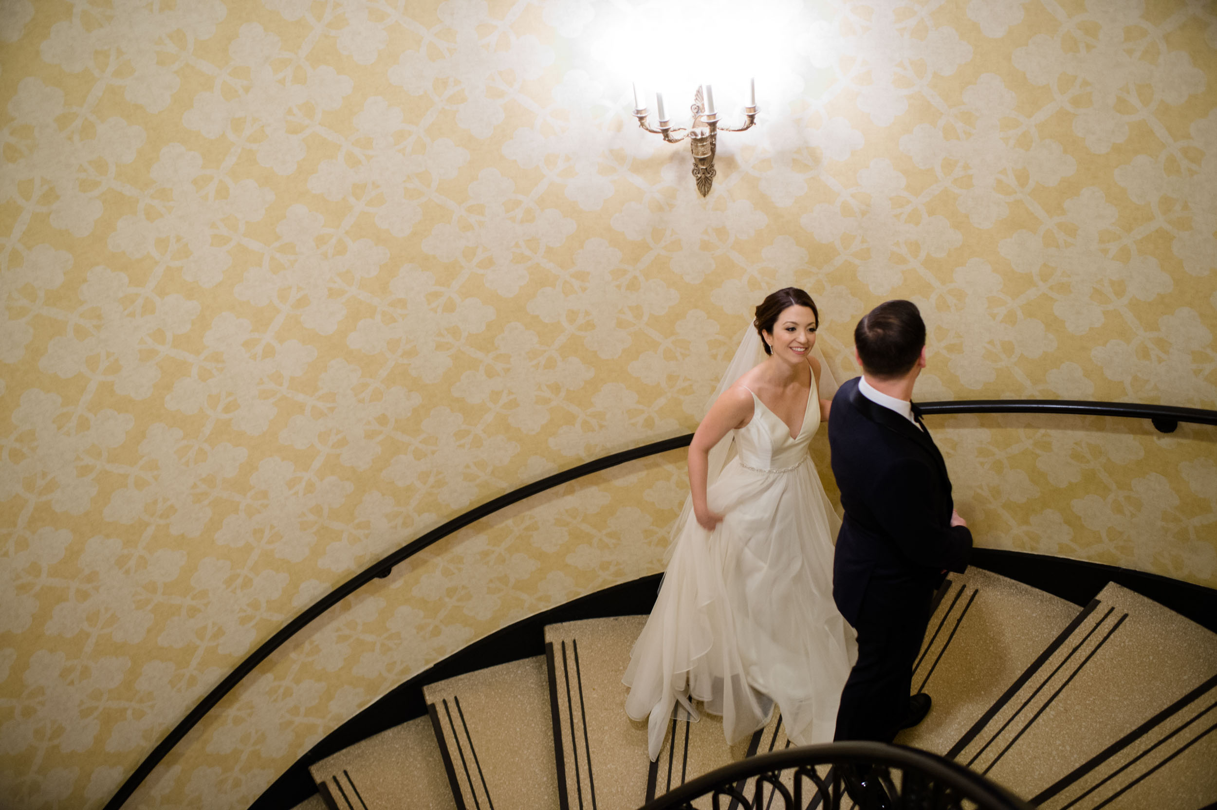 Bride and groom's first look on spiral staircase at Palmer House Chicago