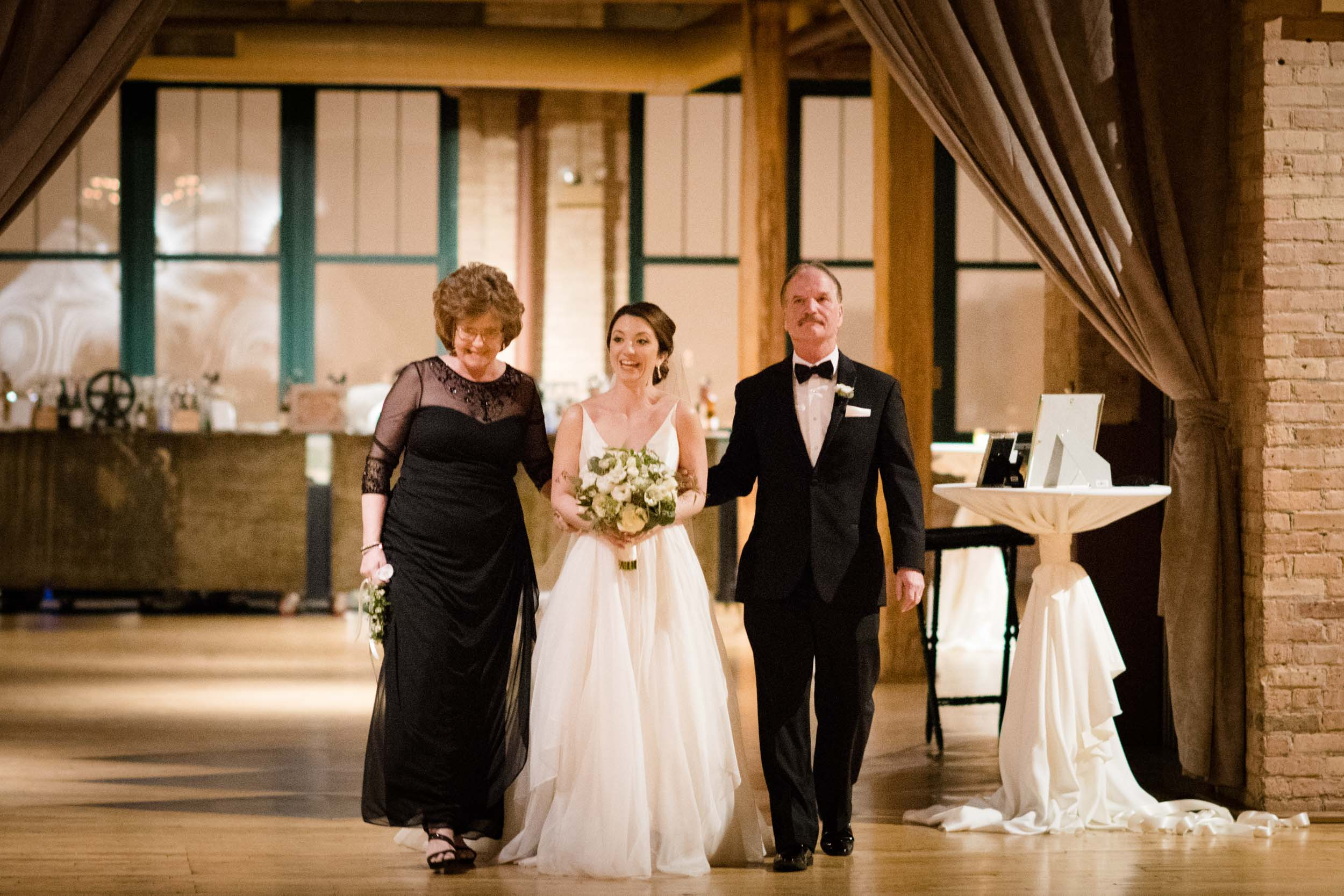Bride and parents enter wedding ceremony at Bridgeport Art Center