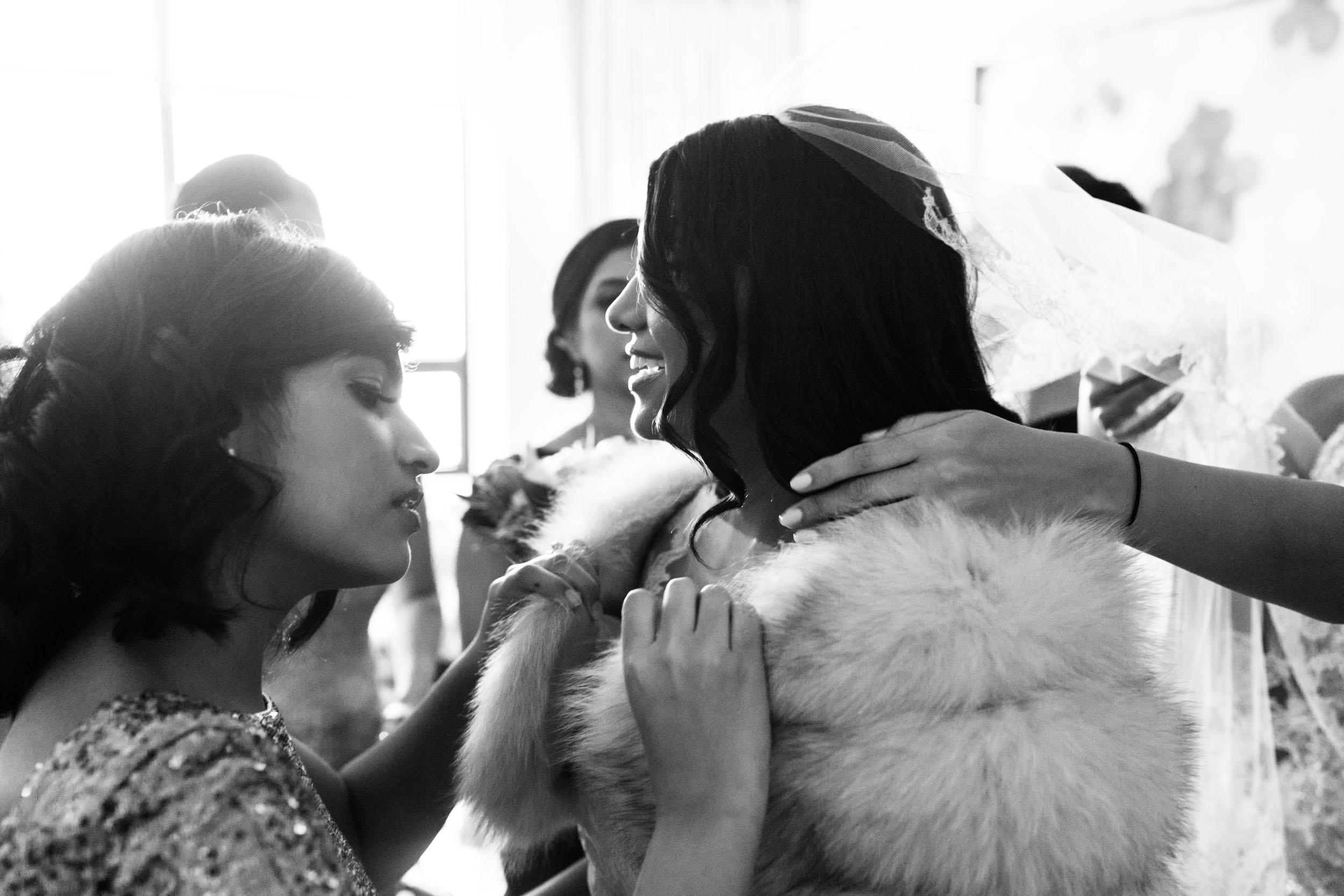 Bridesmaids help bride get ready for wedding at Ritz Carlton Chicago