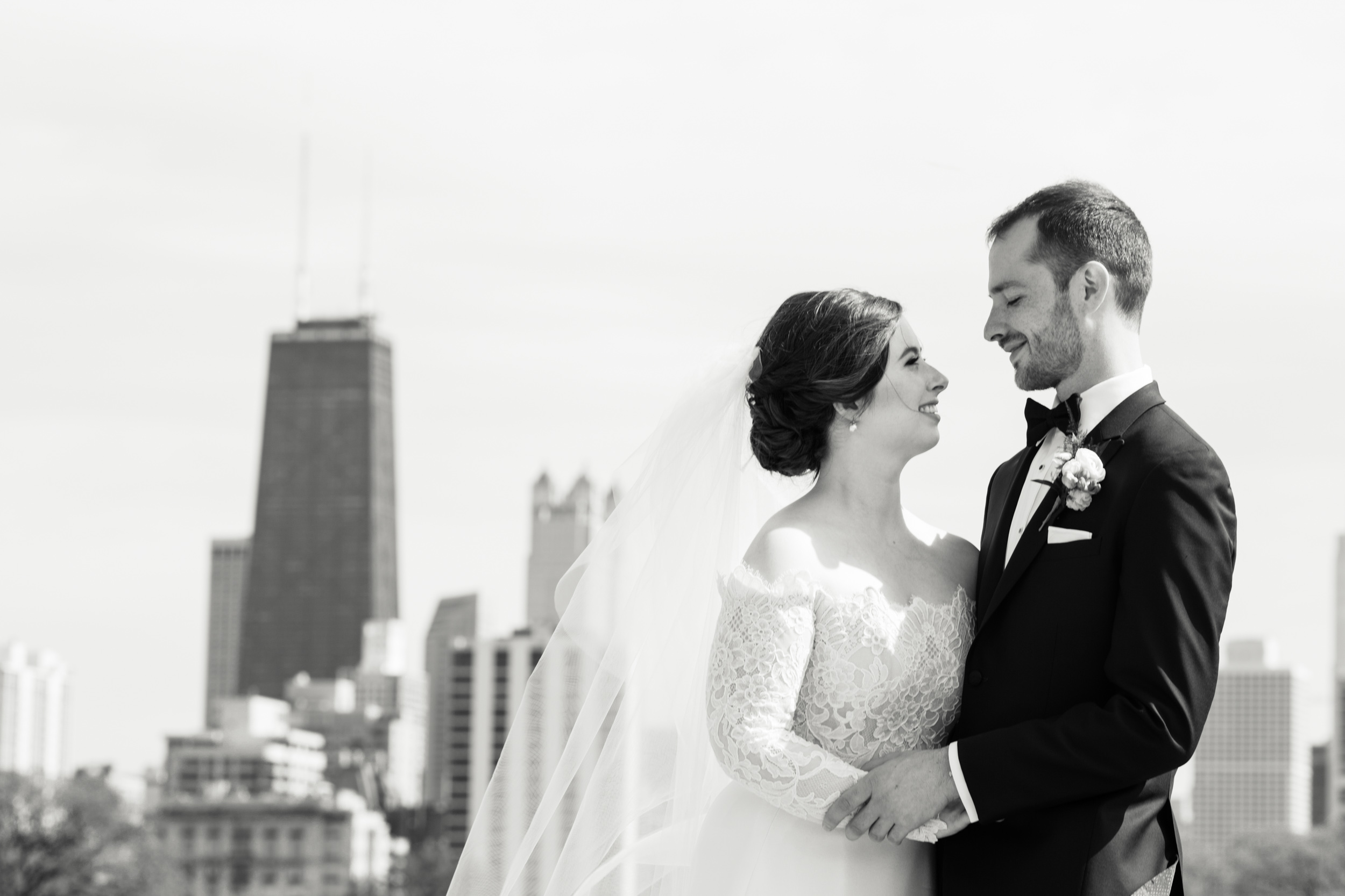 Bride and groom portrait Chicago skyline Lincoln Park Cafe Brauer