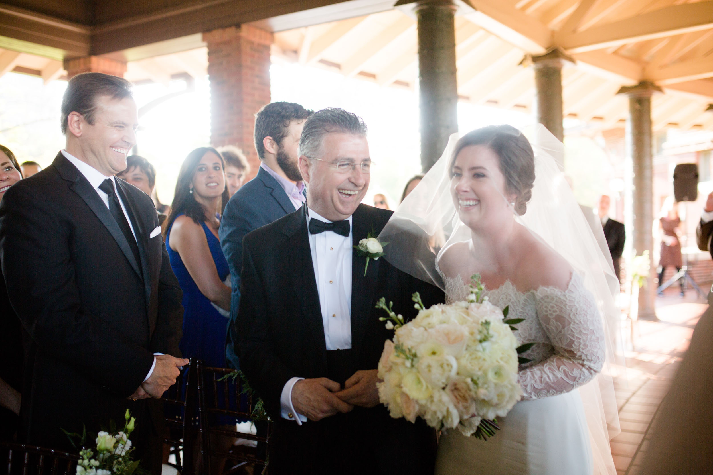 Bride and her father walk down the aisle Chicago Cafe Brauer Wedding Ceremony spring