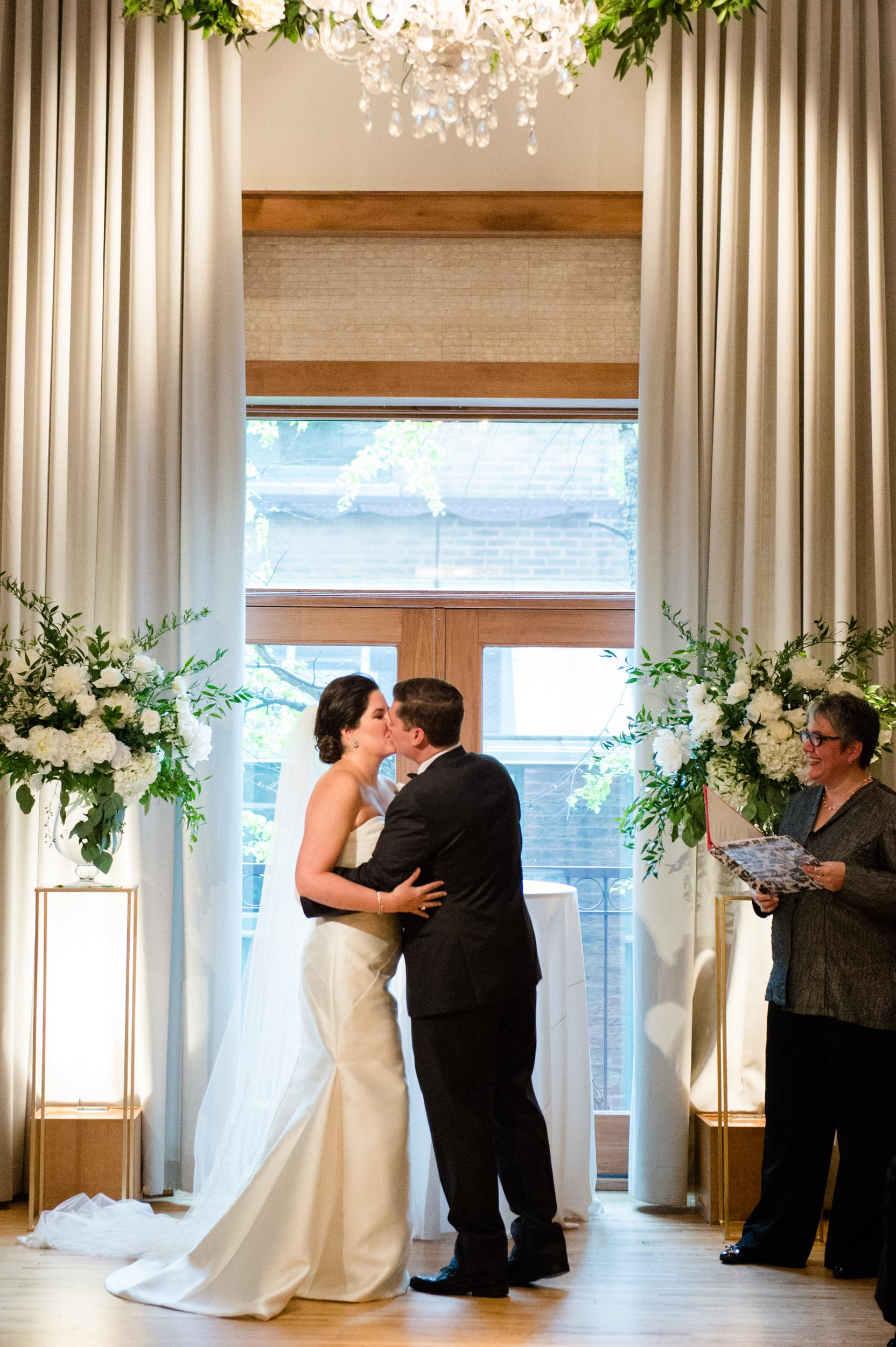 This Ivy Room Chicago wedding ceremony featured gold, white, and green accents and florals.