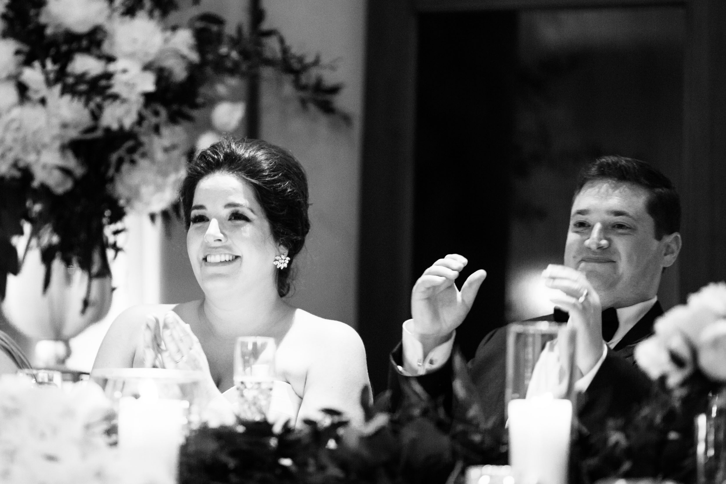 The bride and groom reacted to their friends' speeches and toasts at their Ivy Room Chicago wedding last spring.