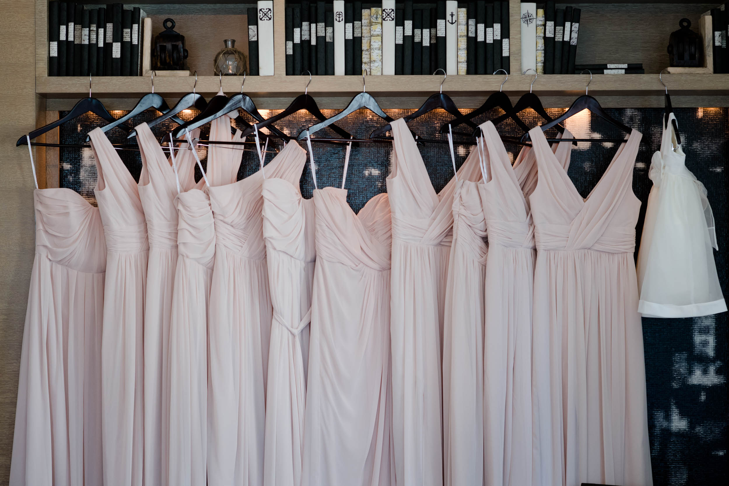 The bridesmaids chose mismatched blush dresses for the Harold Washington Library wedding in Chicago.