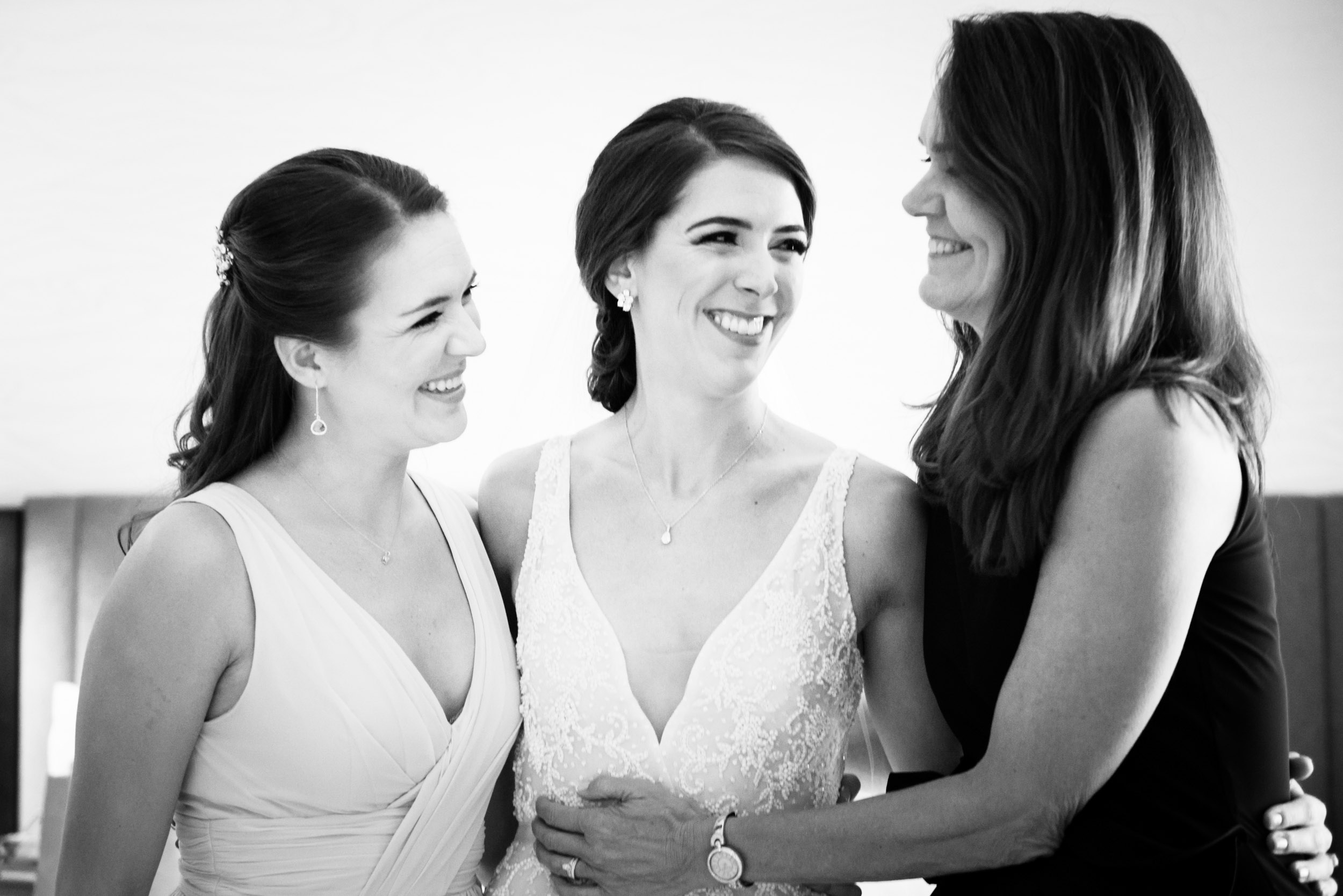 We love this candid photo of the bride and her family in the bridal suite at the Sheraton Grand in Chicago.
