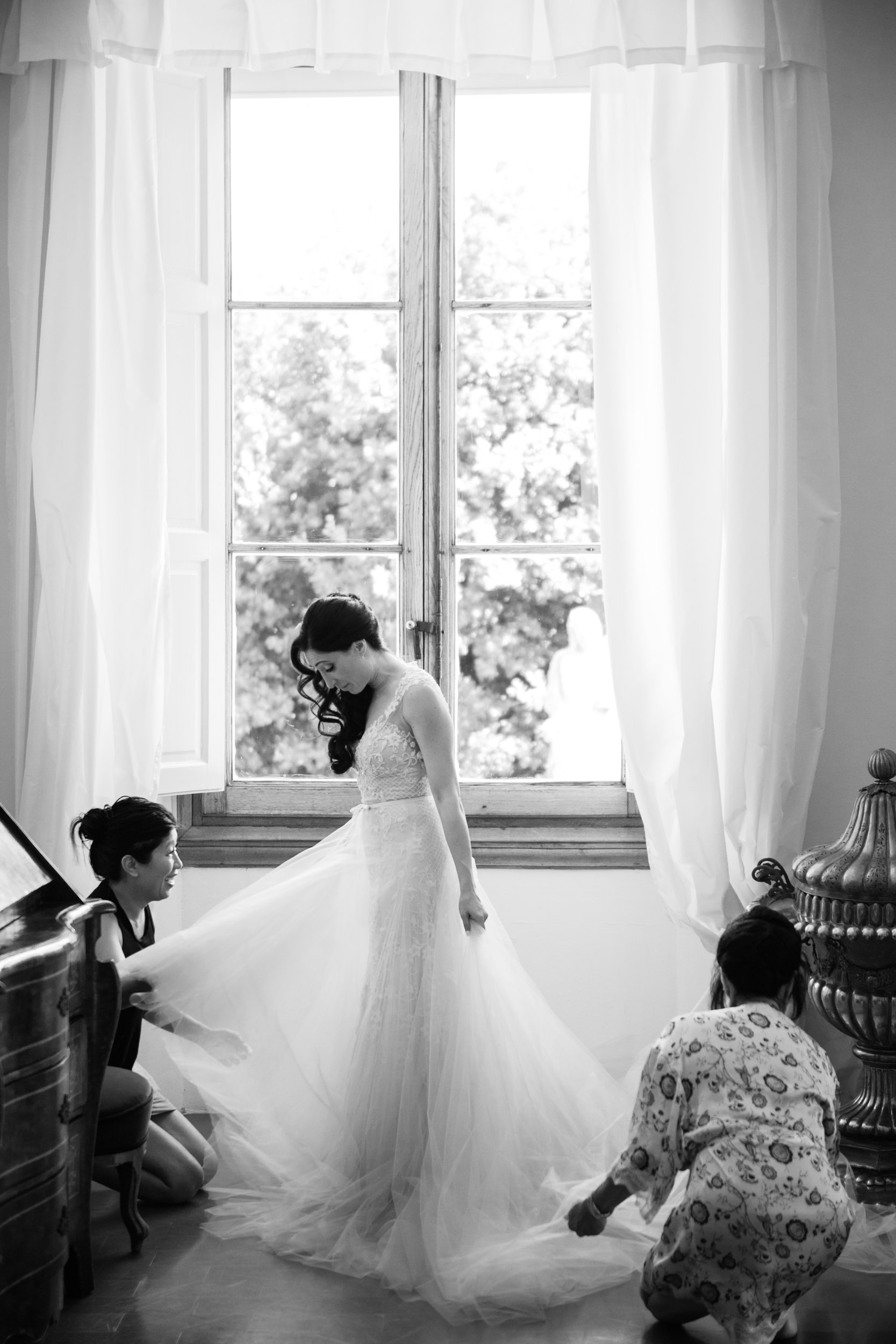 The bride's mother and sister dressed her in custom Monique Lhuillier for her Villa Gamberaia wedding.