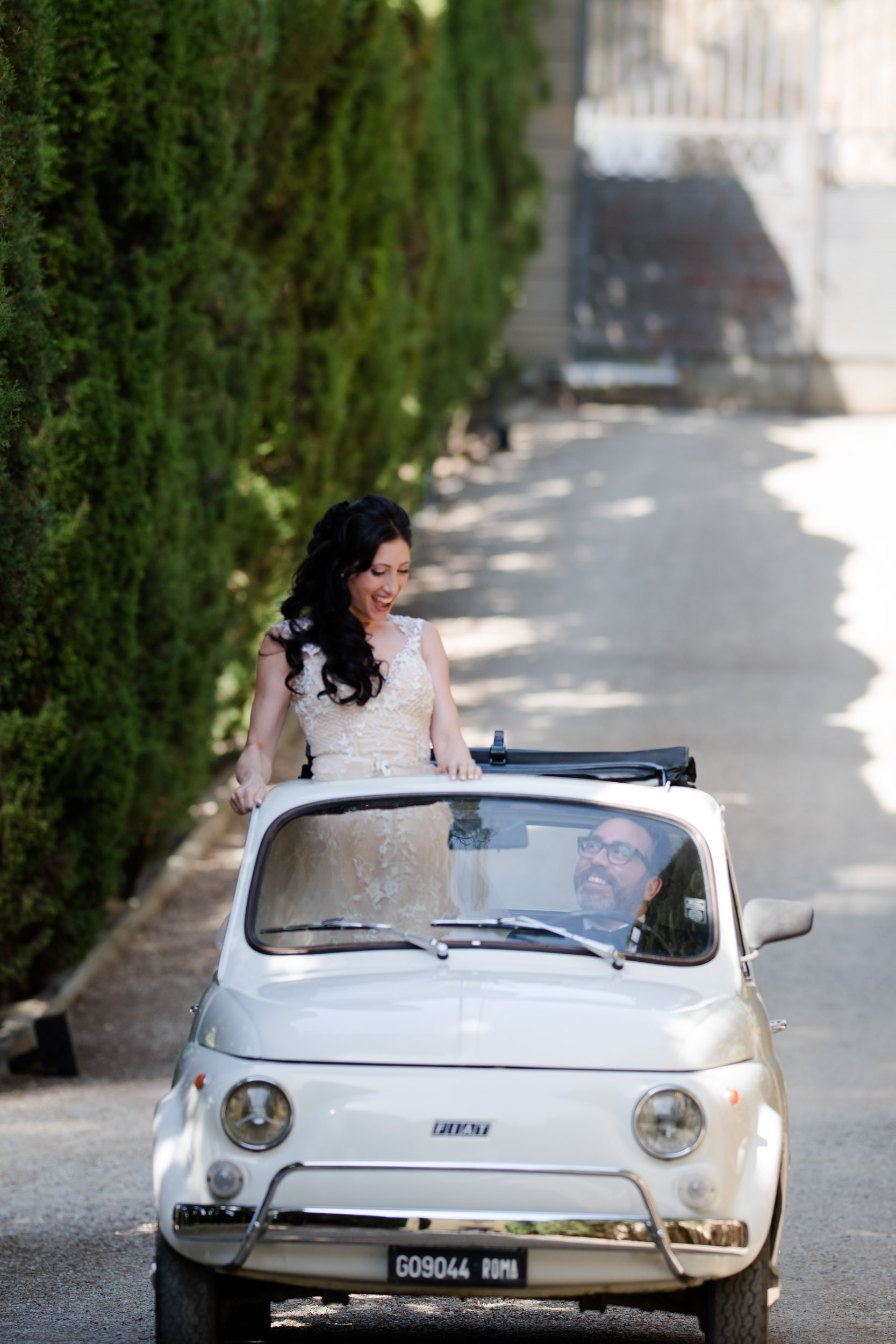 The couple rented a fiat cinquecento to drive during their wedding portraits in Italy.
