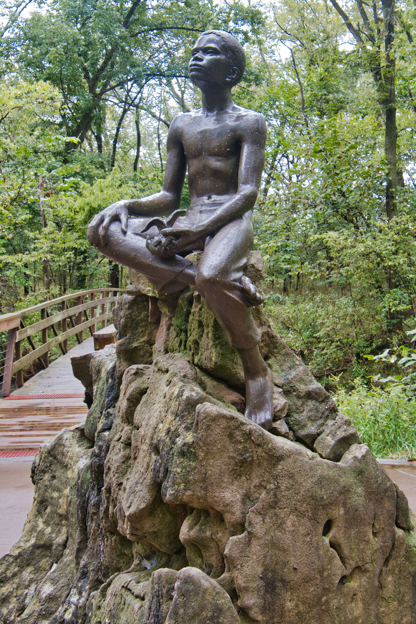 A statue of G. W. Carver as a boy in the woods he loved.