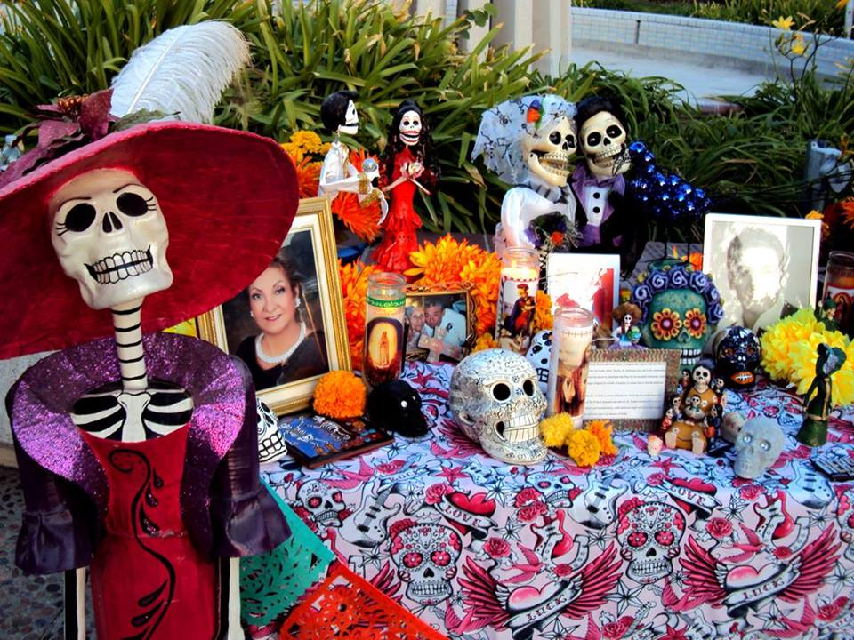 A typical Day of the Dead 'altar' or 'offering' commemorating departed loved ones — in Mexico's uniquely playful and colourful fashion.