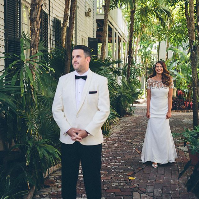 """When I'm setting up the first look, I tell the bride """"when you walk up behind him, you can say his name, tap him on the shoulder, kiss his cheek, or smack him on the back of the head. Josh got smacked 😂#nogroomswereharmedduringtheshootingofthiswedding #keywest #keywestwedding #keywestweddings #oldtownmanor #oldtownmanorweddings #firstlookwedding #firstlook #floridakeys #keyswedding"""