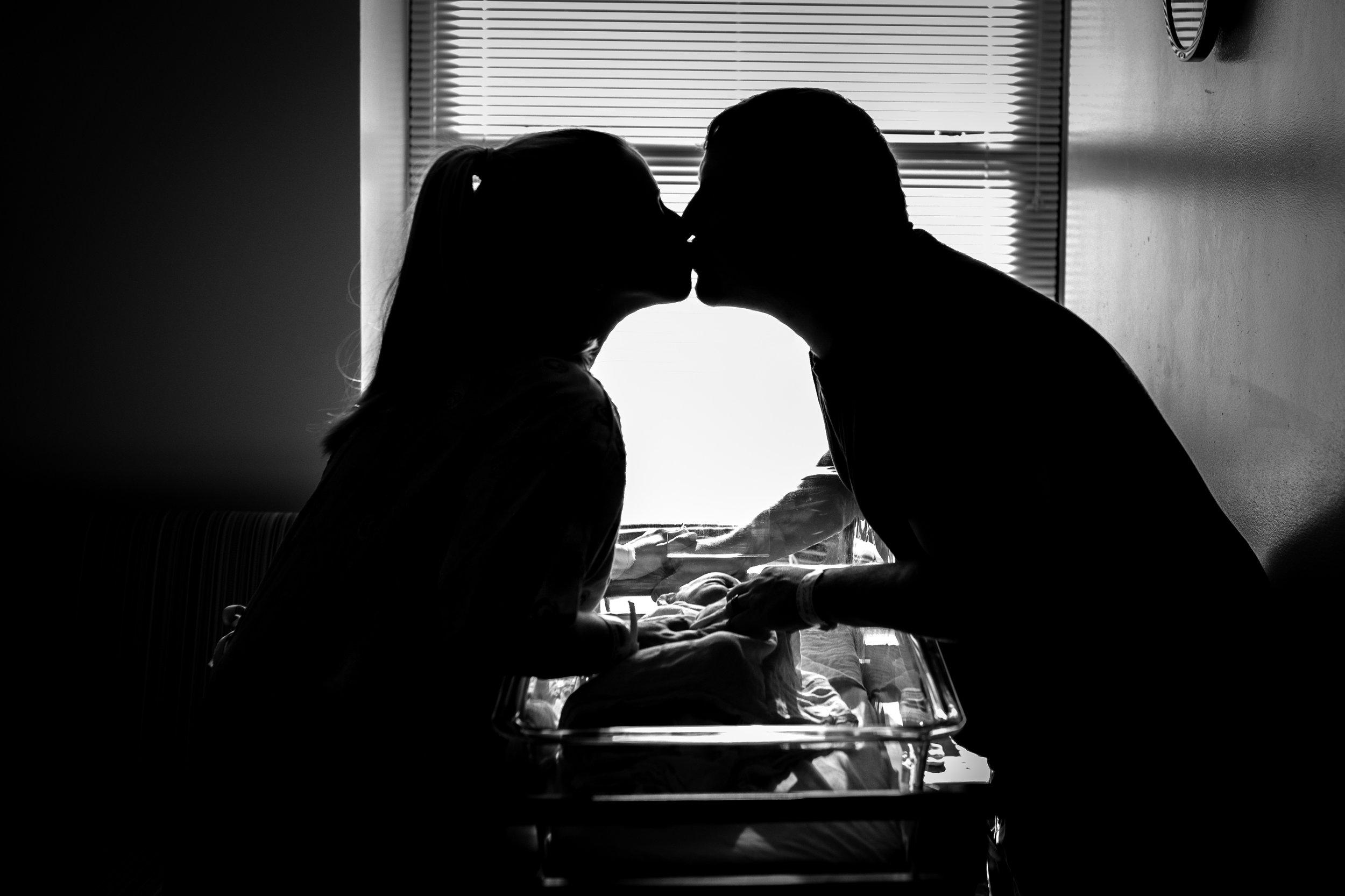 stolen kiss over newborn