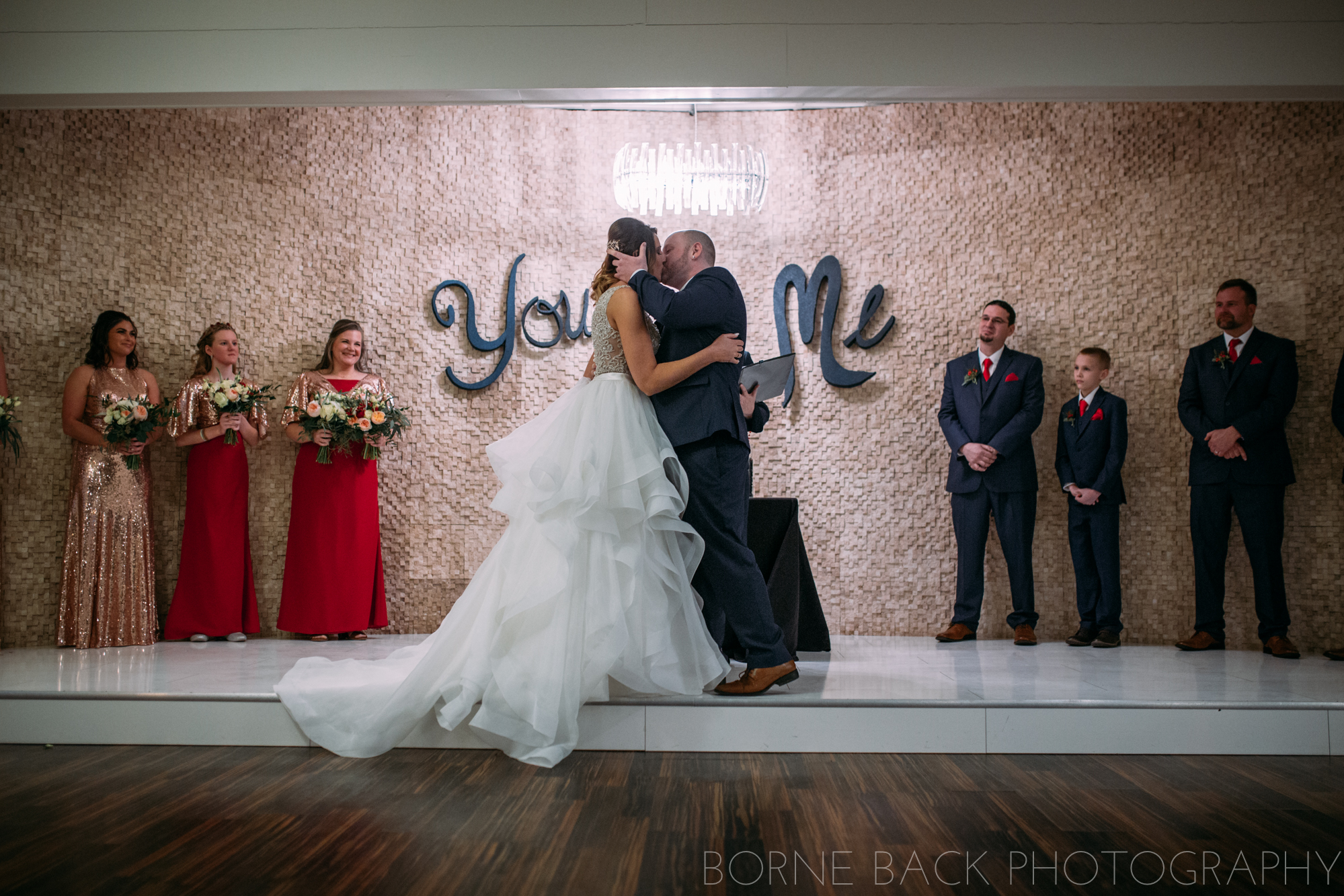 south bend wedding photographer captures first kiss between bride and groom