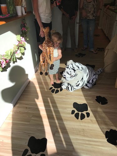 Roman's buddy, Emmy, shows off some of our jungle decor and paw prints