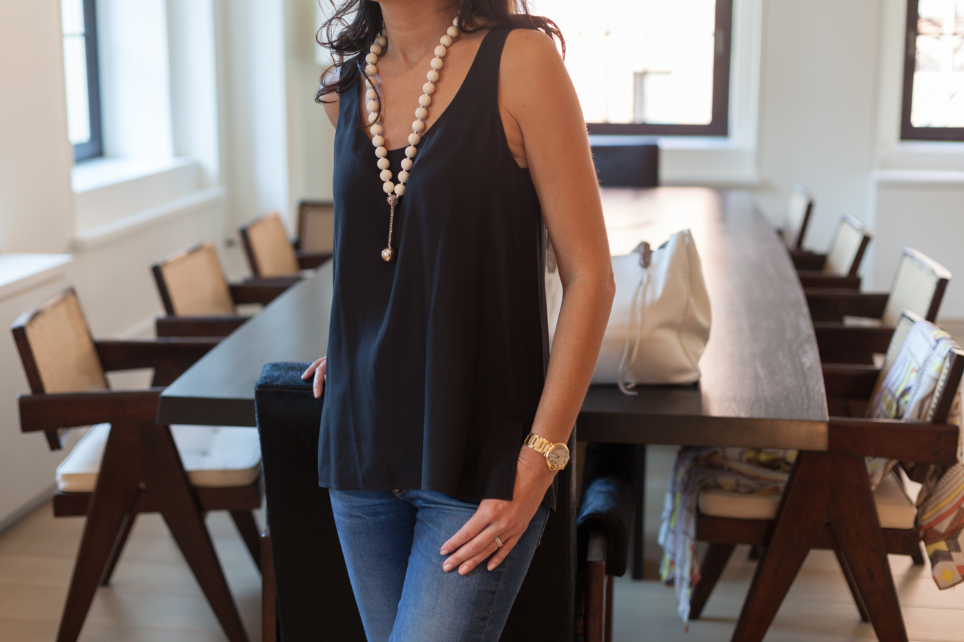 Back in NYC and wearing the Tonia Poulaki necklace with a  Equipment  black silk tank and  J Brand  jeans.