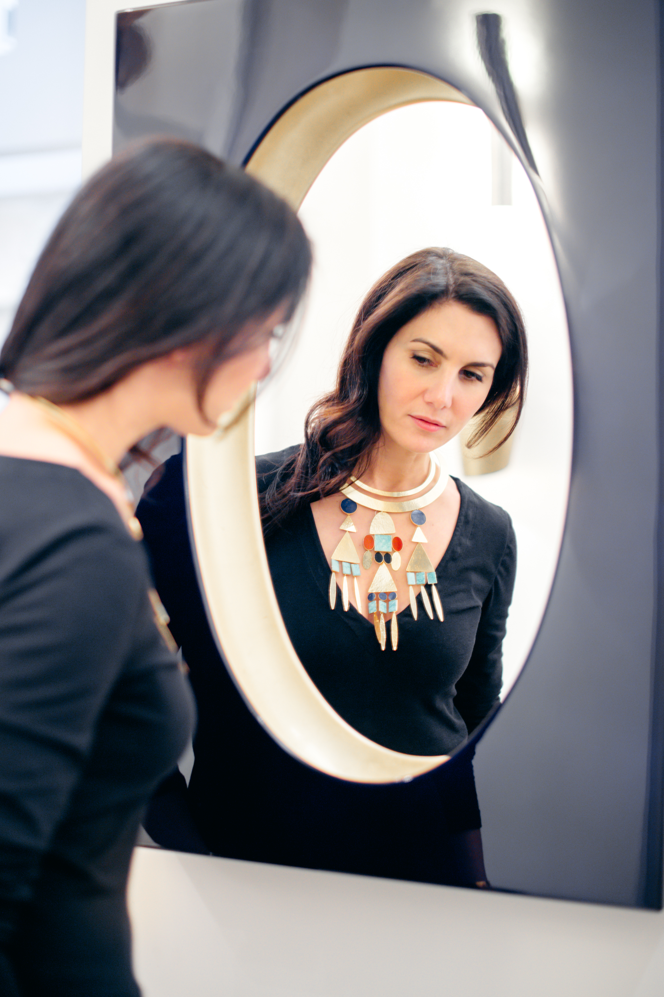 Van der Straeten's stunning gold and semi-precious stone  Amazone  necklace reflected in his  Miroir Magique
