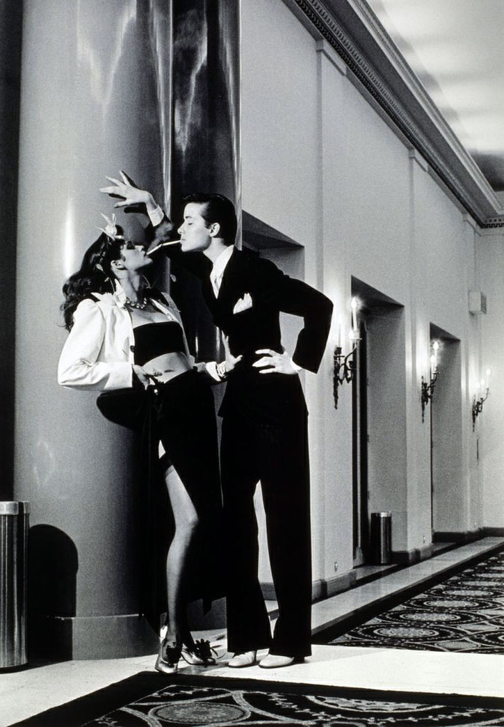 Helmut Newton,  Woman into Man, Lighting a Cigarette , Vogue, 1979