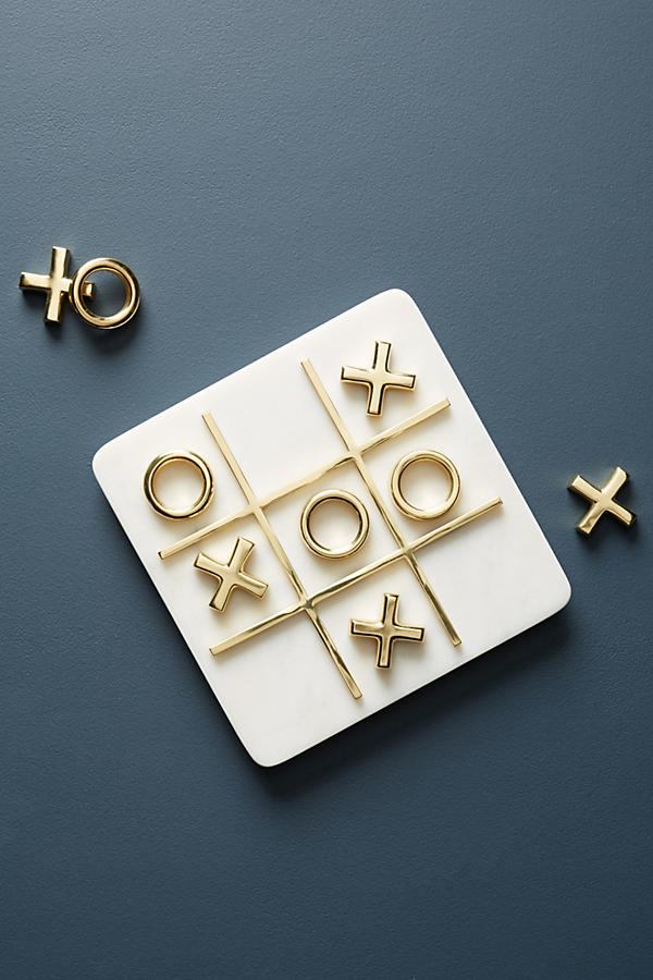 MARBLE TIC-TAC-TOE SET - $78   This marble & brass games doubles as décor when not in use.