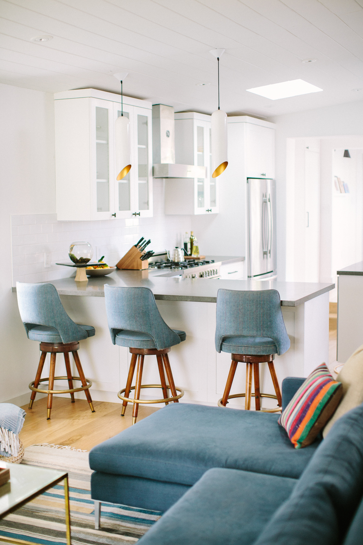 Modern, white mid-century kitchen designed by Carly Waters Style